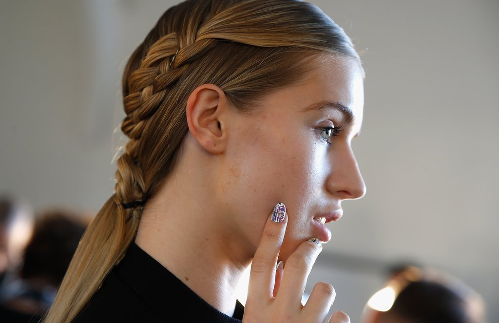 Cristian Siriano: Wide Double Braids that transform into a low pony tail