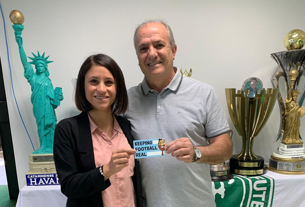 Judith with the club President Ivan Tozzo, both holding #BabaStickers (Photo: Yotam Tzuker)