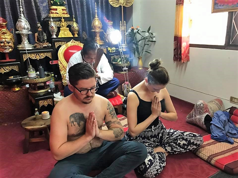 Having our new Buddhist prayer tattoos blessed. My husband and I recognize as Buddhists so this was a magical experience for us.