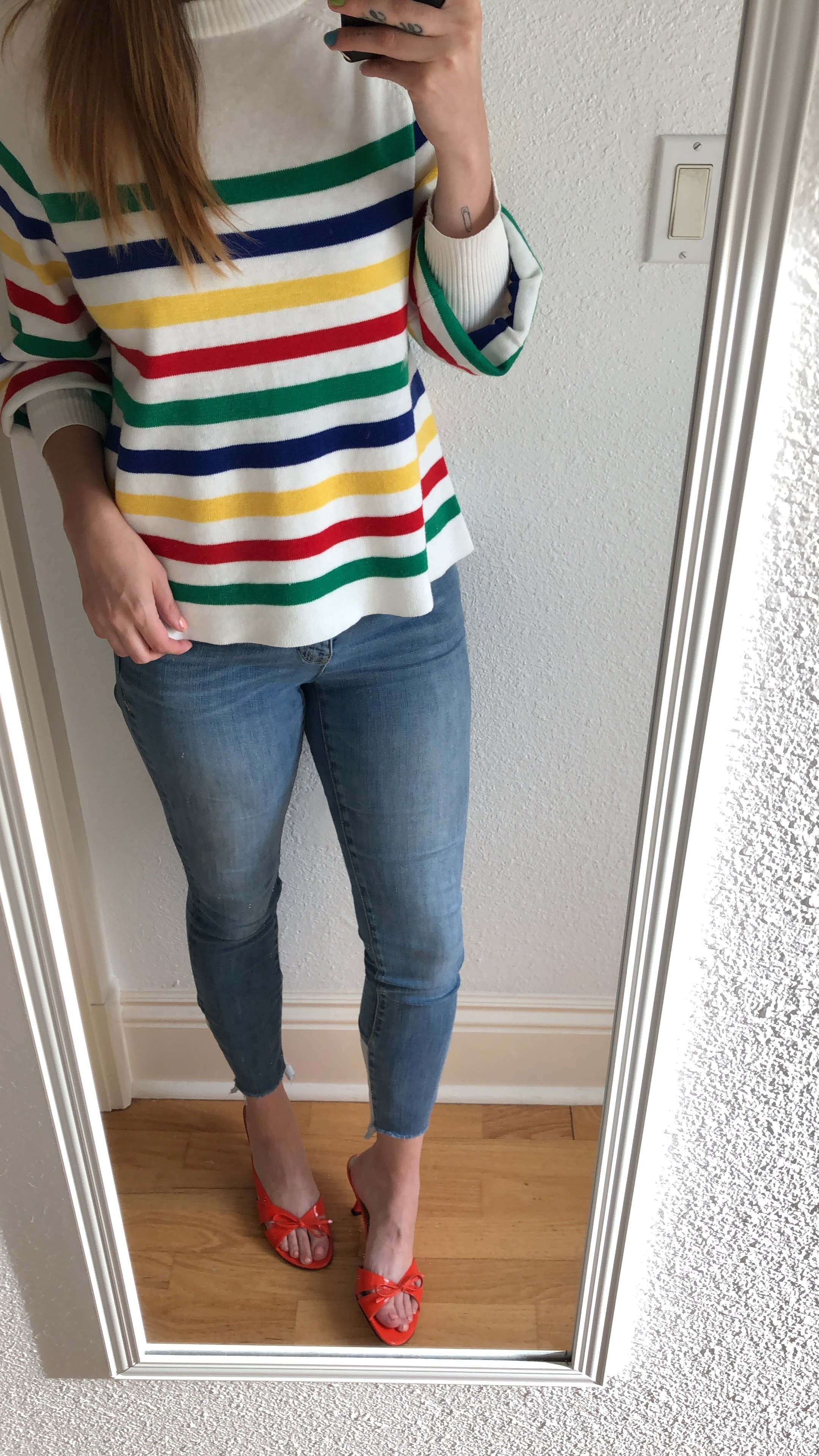I love my rainbow sweater paired with cute jeans and some bold kitten heels!