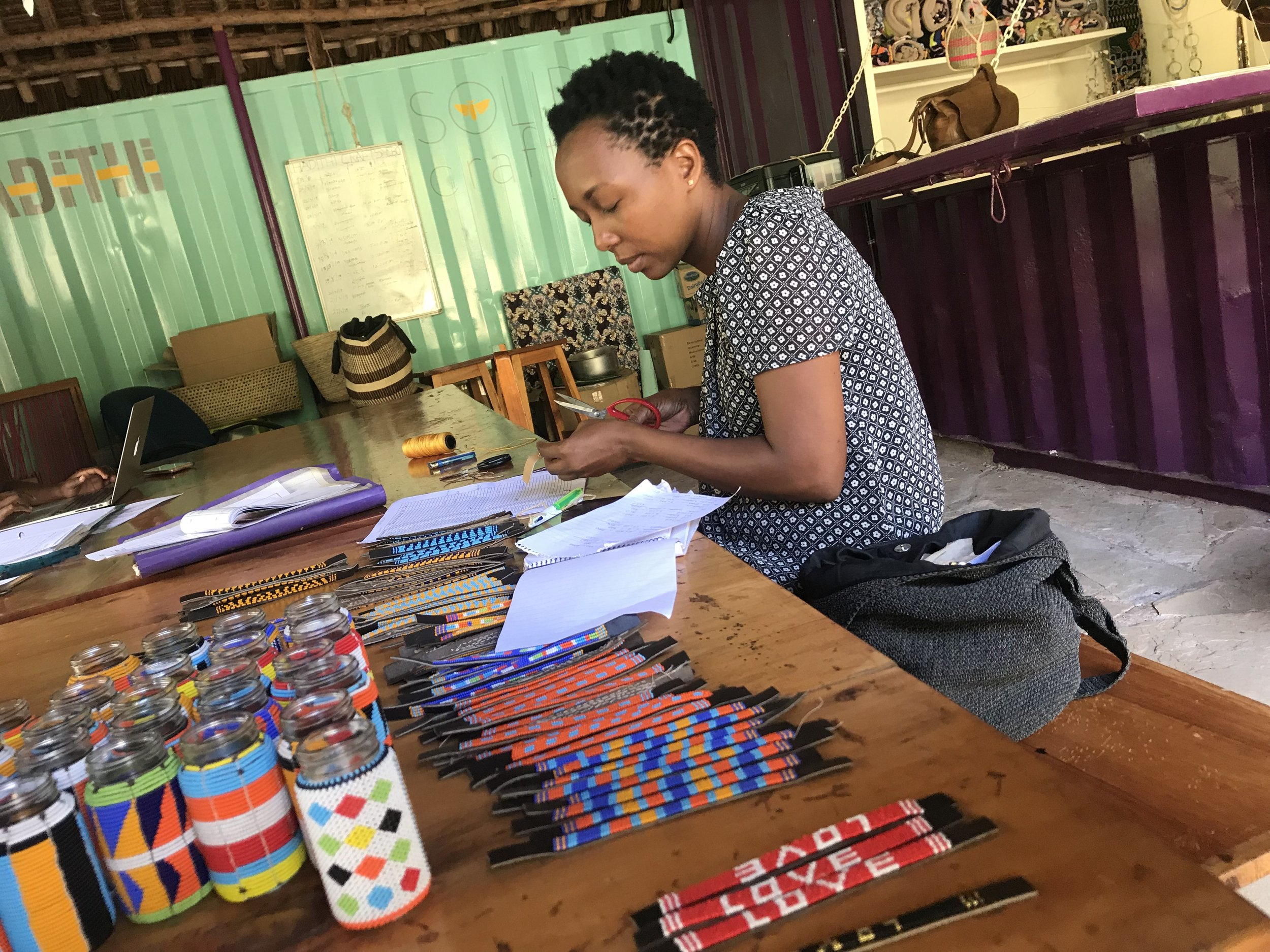 Kate Sau is in charge of the beading. She trains the beaders, purchases the crafts and finishing them.