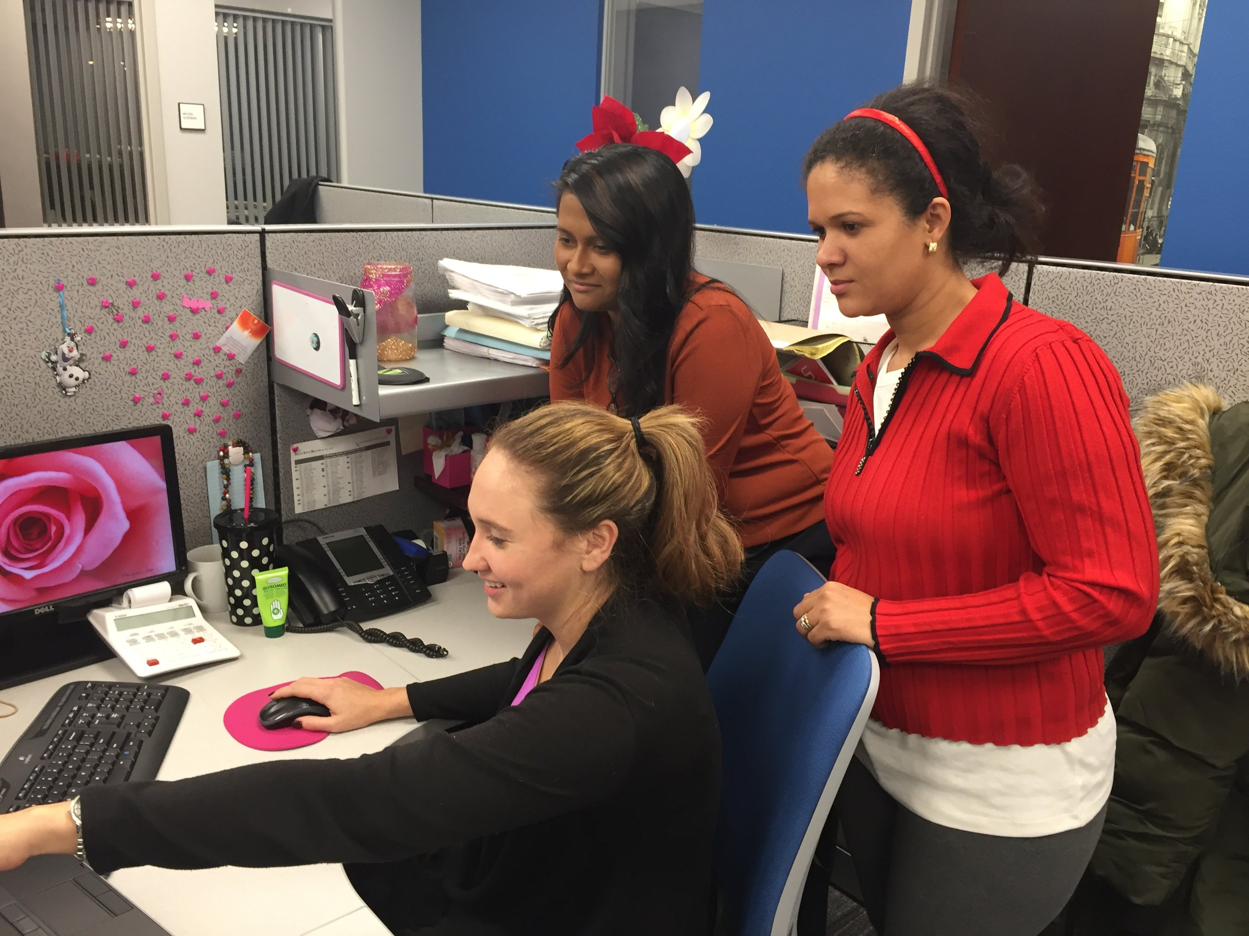 Michelle Greco demonstrates software for Margaret Daniel and Mercedes Sanchez