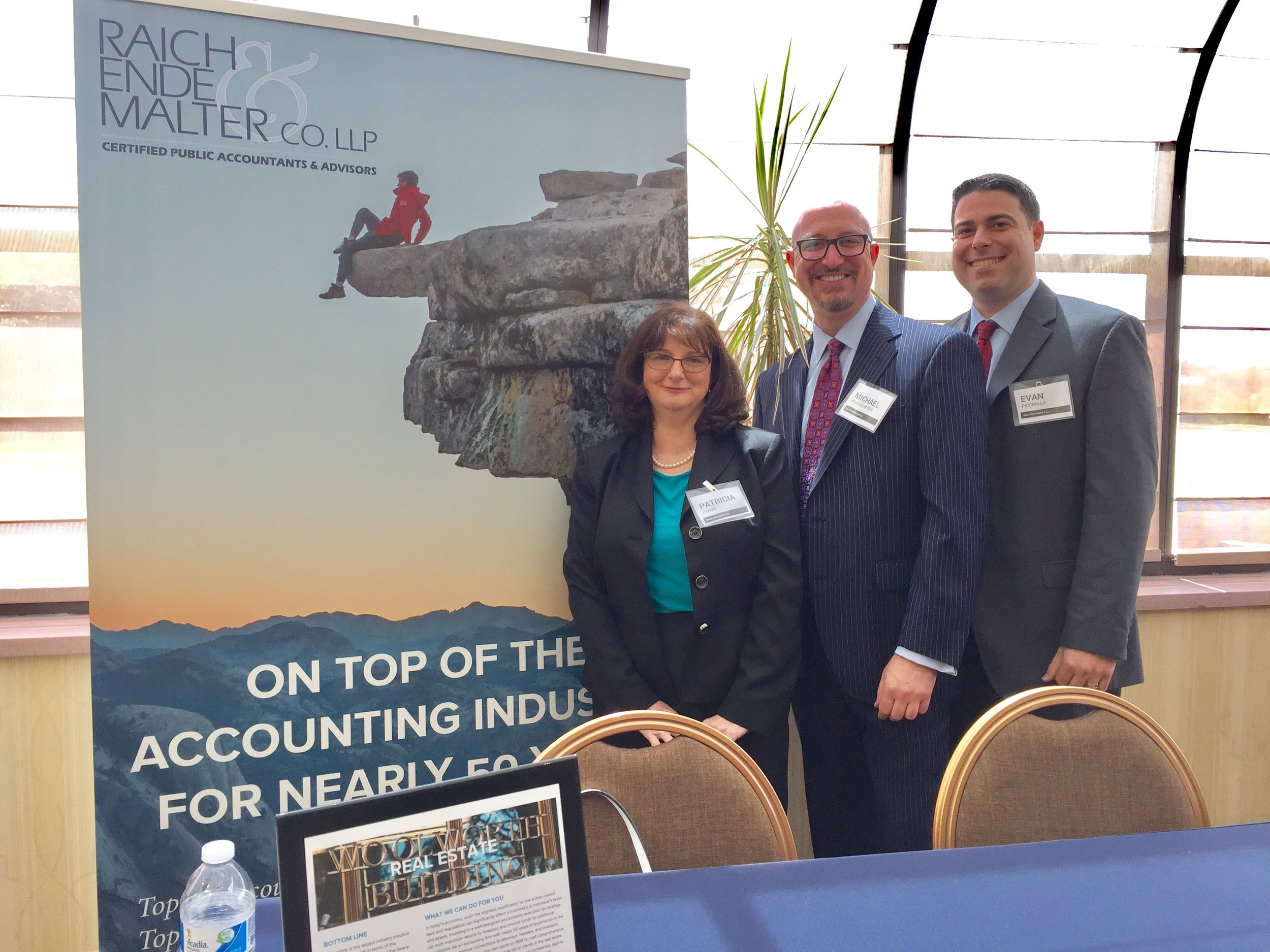 Senior tax manager Patricia Evans, partner Michael Rosengarten, and tax supervisor Evan Piccirillo.