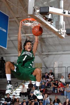 Alex Barnett dunks.