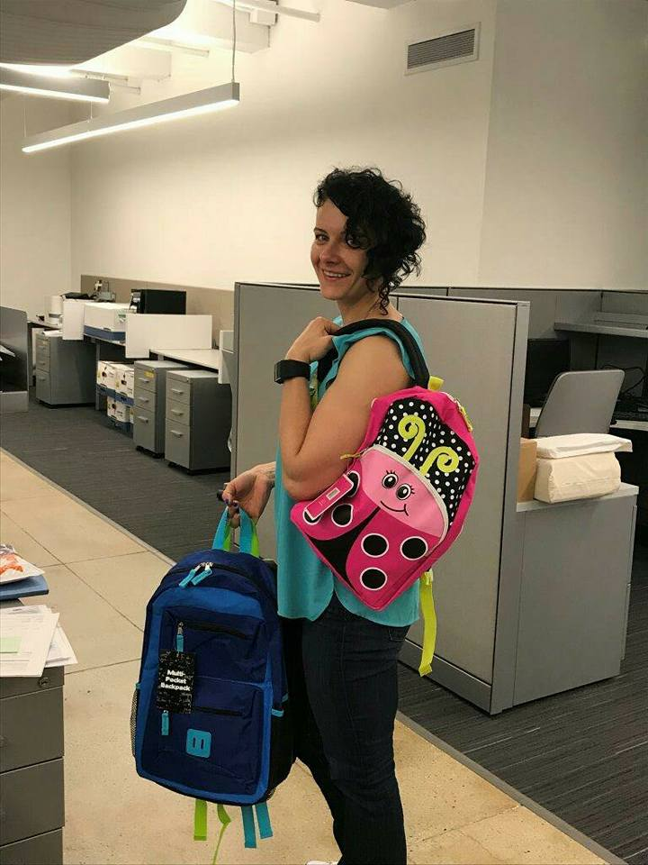 Patrycja Leszczynski tries a backpack on for size.