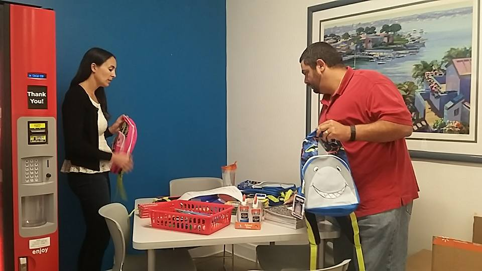 Amanda Rinaldo and Mike Meilak fill backpacks.