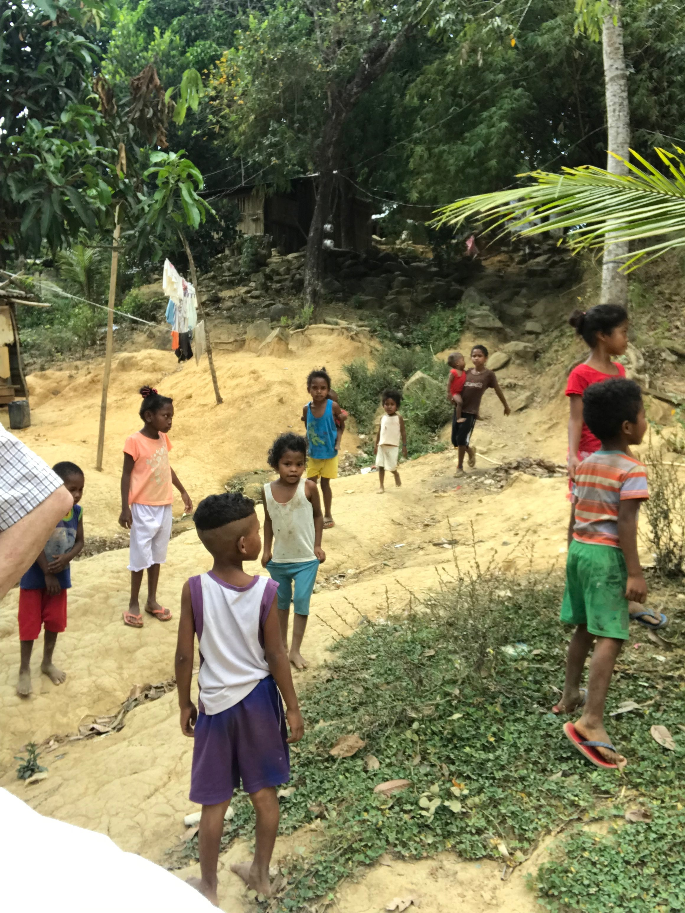 Some of the kids following us around while visiting the village.