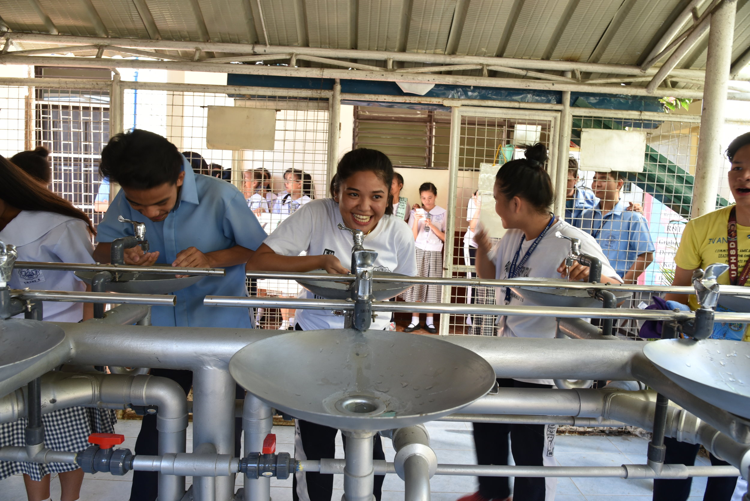 Project Three - Fountain of Life RevitalizationTen years ago, the same Rotary Clubs joined together to provide a way for the youth in this high school to have fresh clean water. Before this fountain, there was no clean water for the thousands of students at this school.We helped provide some new mechanical equipment and maintenance to the fountain.