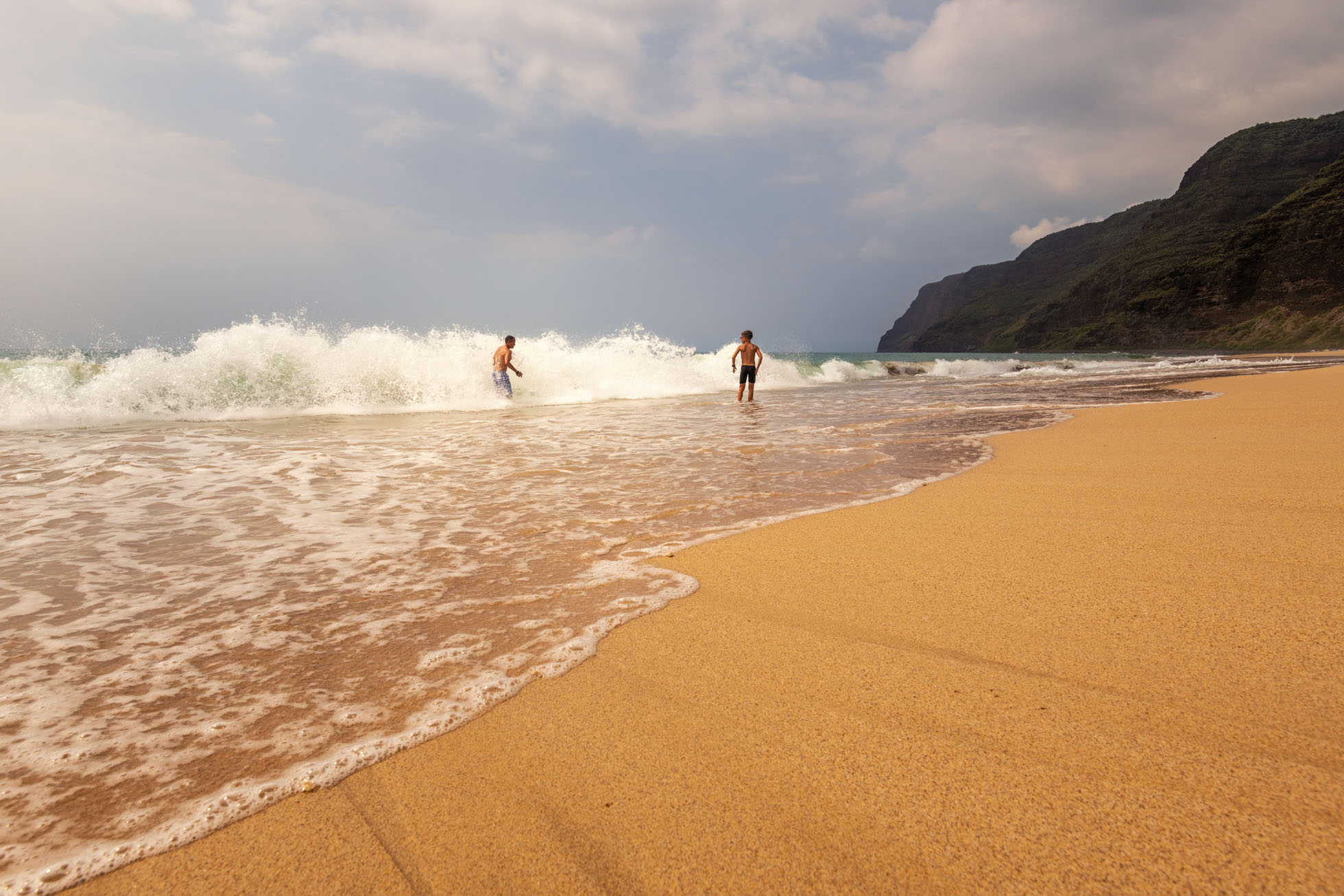 My husband and youngest son in the waves in Kauai