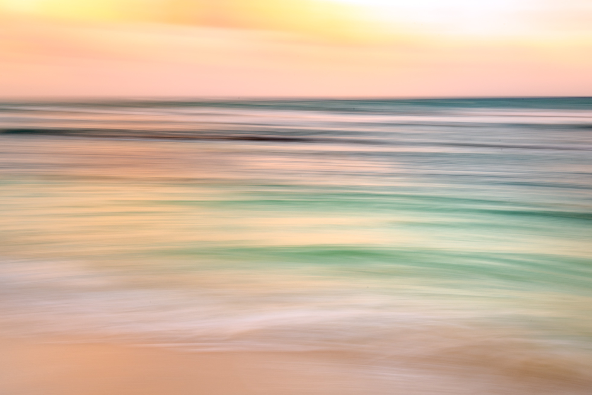 The colors of a sunset and gorgeous water in Mexico provided a great opportunity for this panning seascape.
