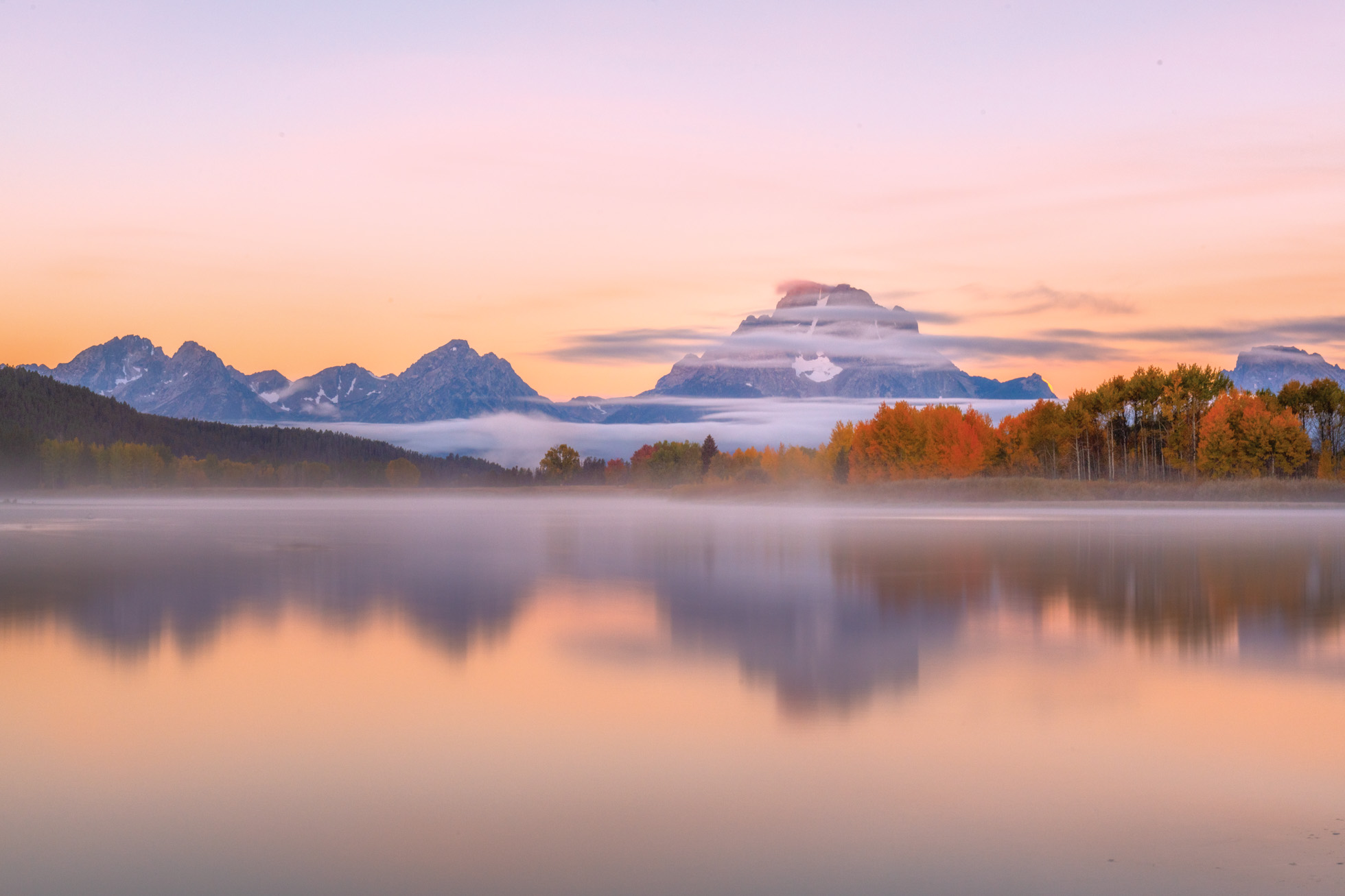 60mm brings me closer to Mt. Moran in this sunrise scene and creating nice symmetry between the mountains and their reflection.