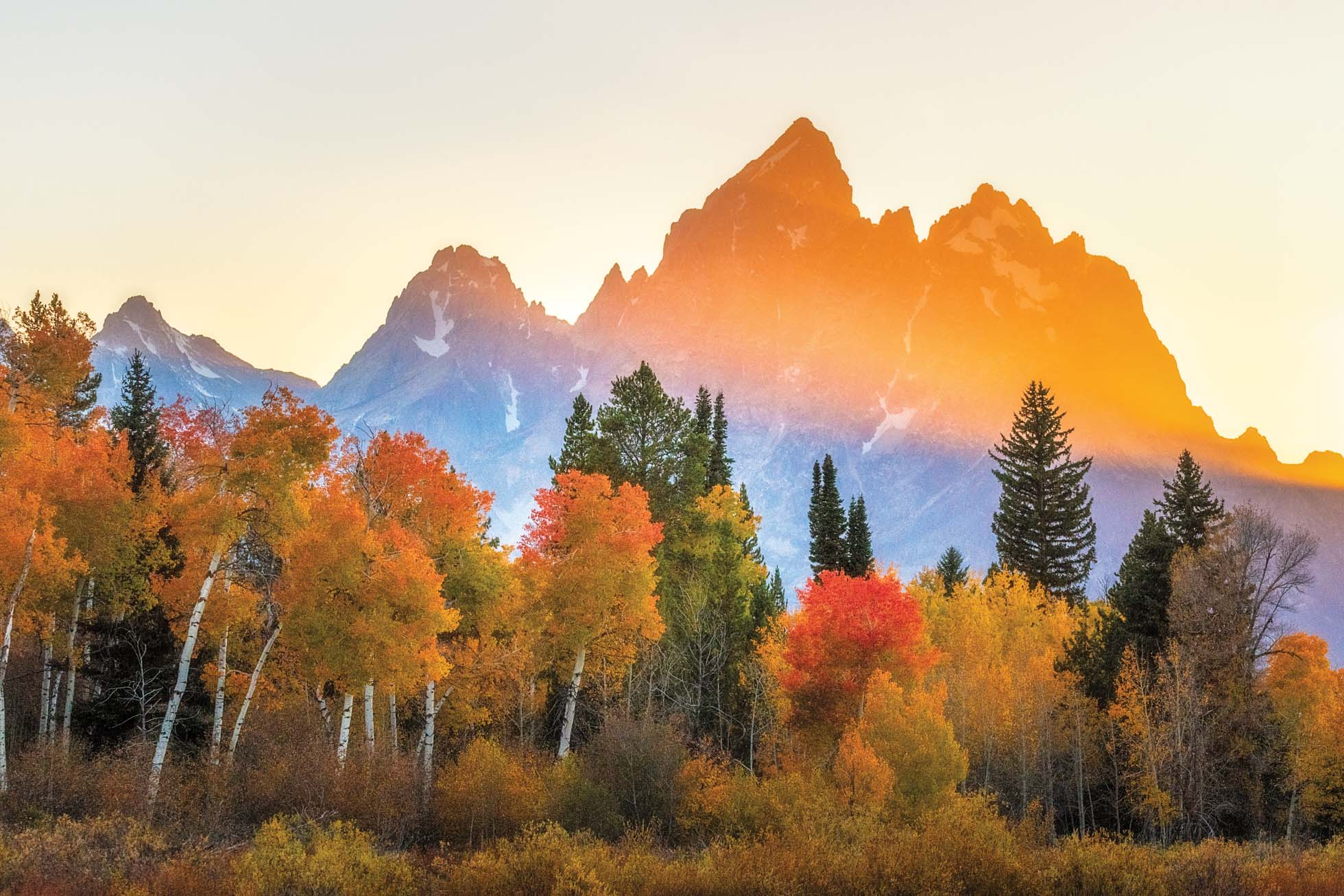 150mm  As the sunset's golden light hit the Grand Teton, I captured this at 150mm to isolate the light on the Grand complimented by the colorful autumn foliage in the foreground.