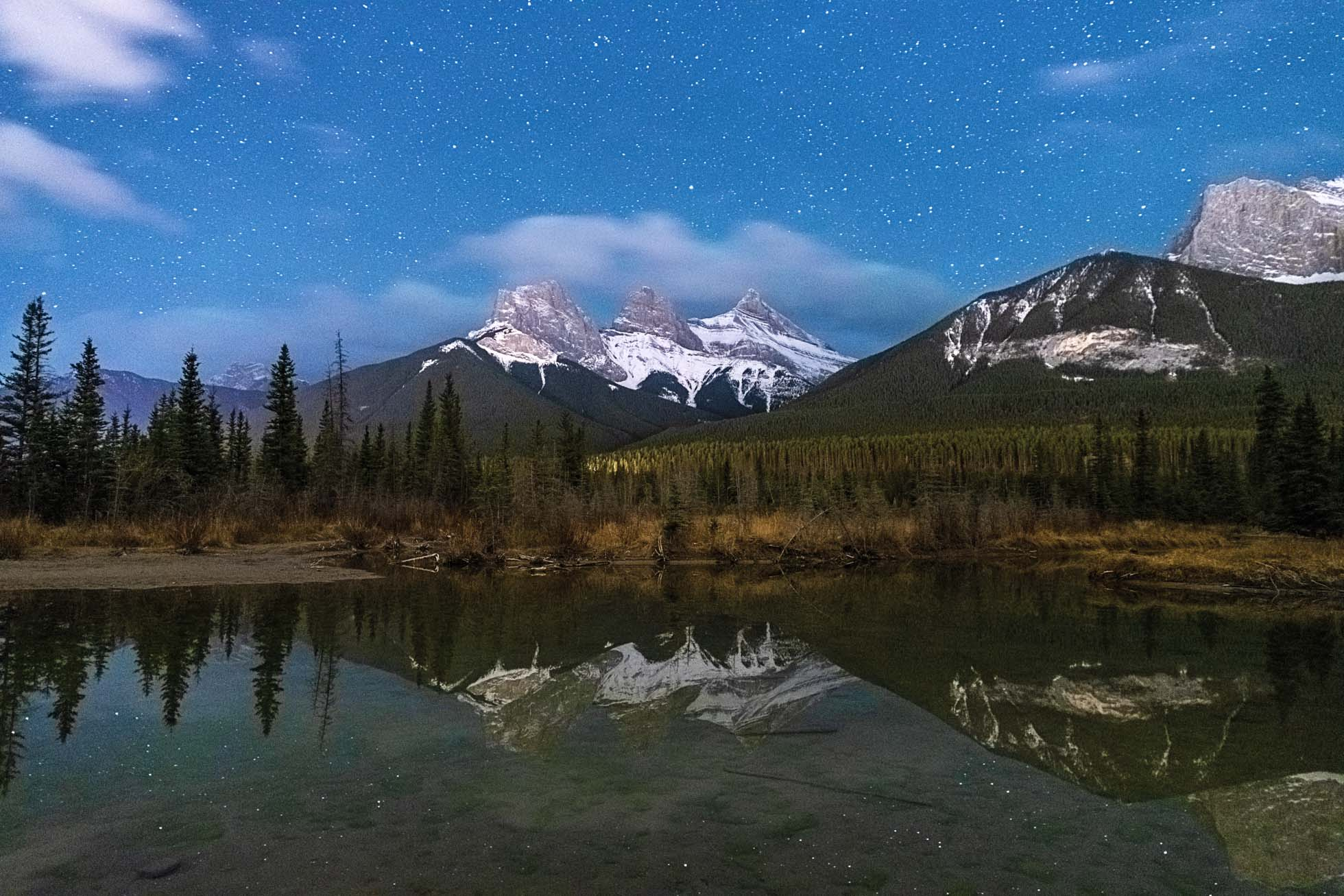 A starry evening at the Three Sisters in Canmore, Alberta Canada