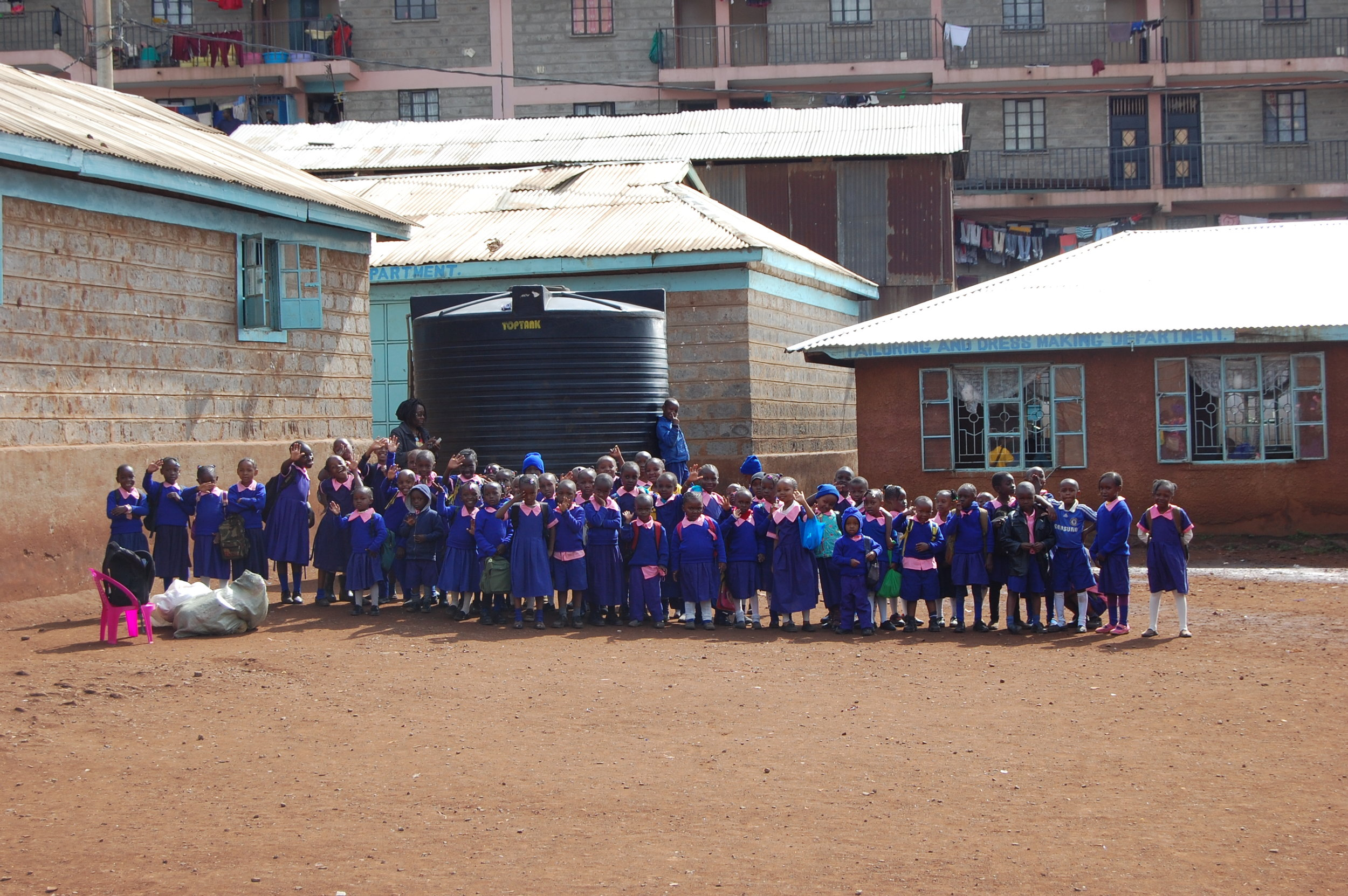 The YMCA in Linesaba serves over 400 students. Here, children from the younger classes greet us at the gate.