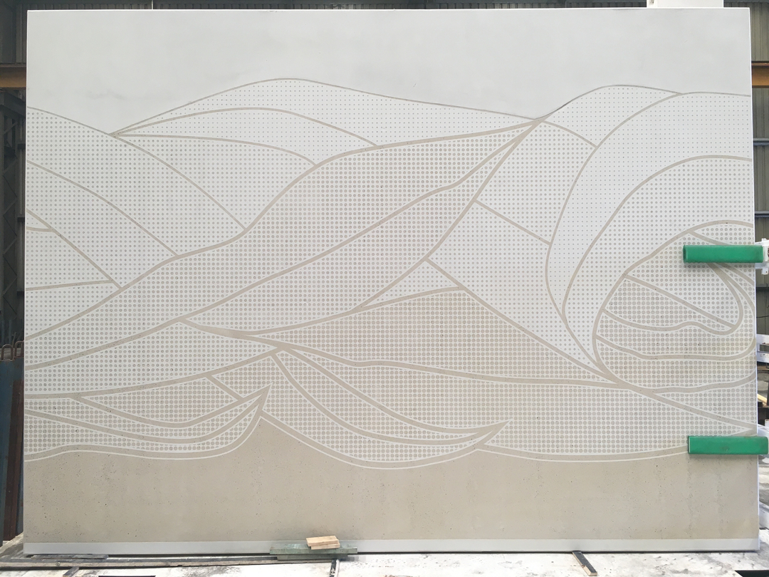 Precast concrete panels are high-pressure hosed to reveal the gum leaf motif
