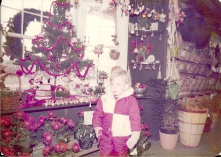 Chris in Christmas shop young red coat.jpg