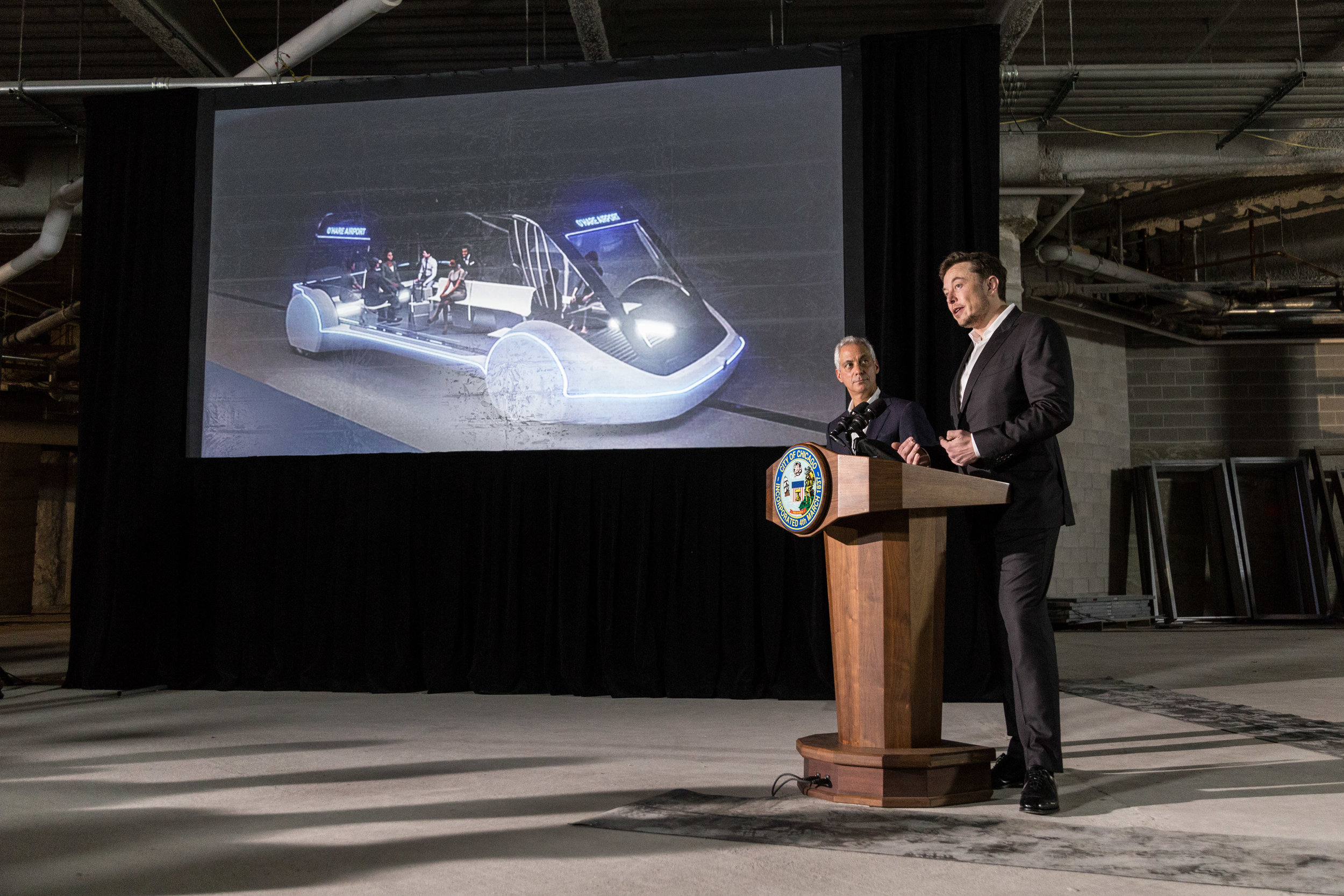 Elon Musk and Mayor Rahm Emanuel addressed plans for a high-speed underground transportation system that would link downtown Chicago to O'Hare in 12 minutes, Thursday June 14, near the Pedway entrance to Block 37. | Erin Brown/Sun-Times
