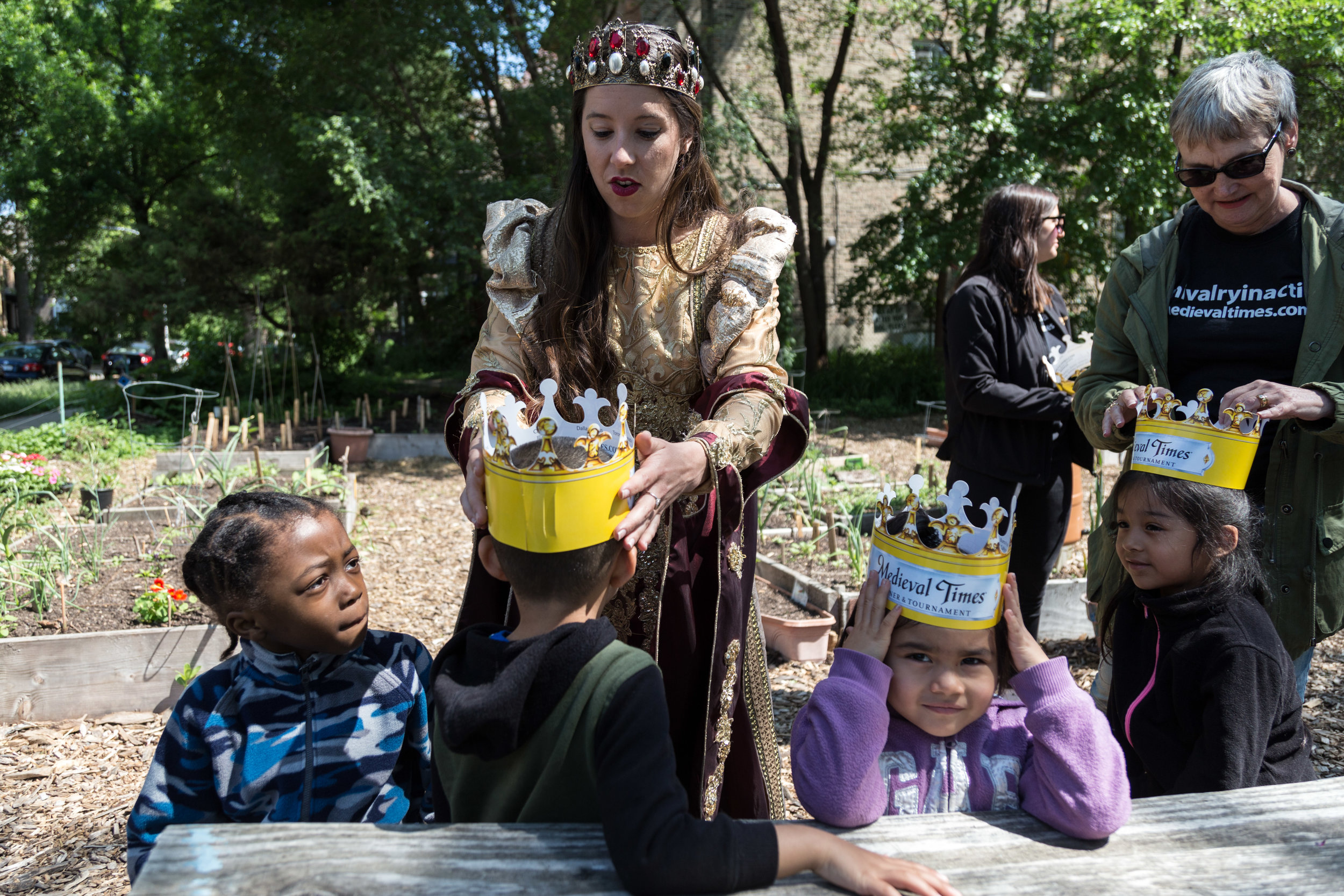 Medieval Times Queen Maria Isabella (Allyssa O'Donnell) crowns preschoolers from Christopher House.
