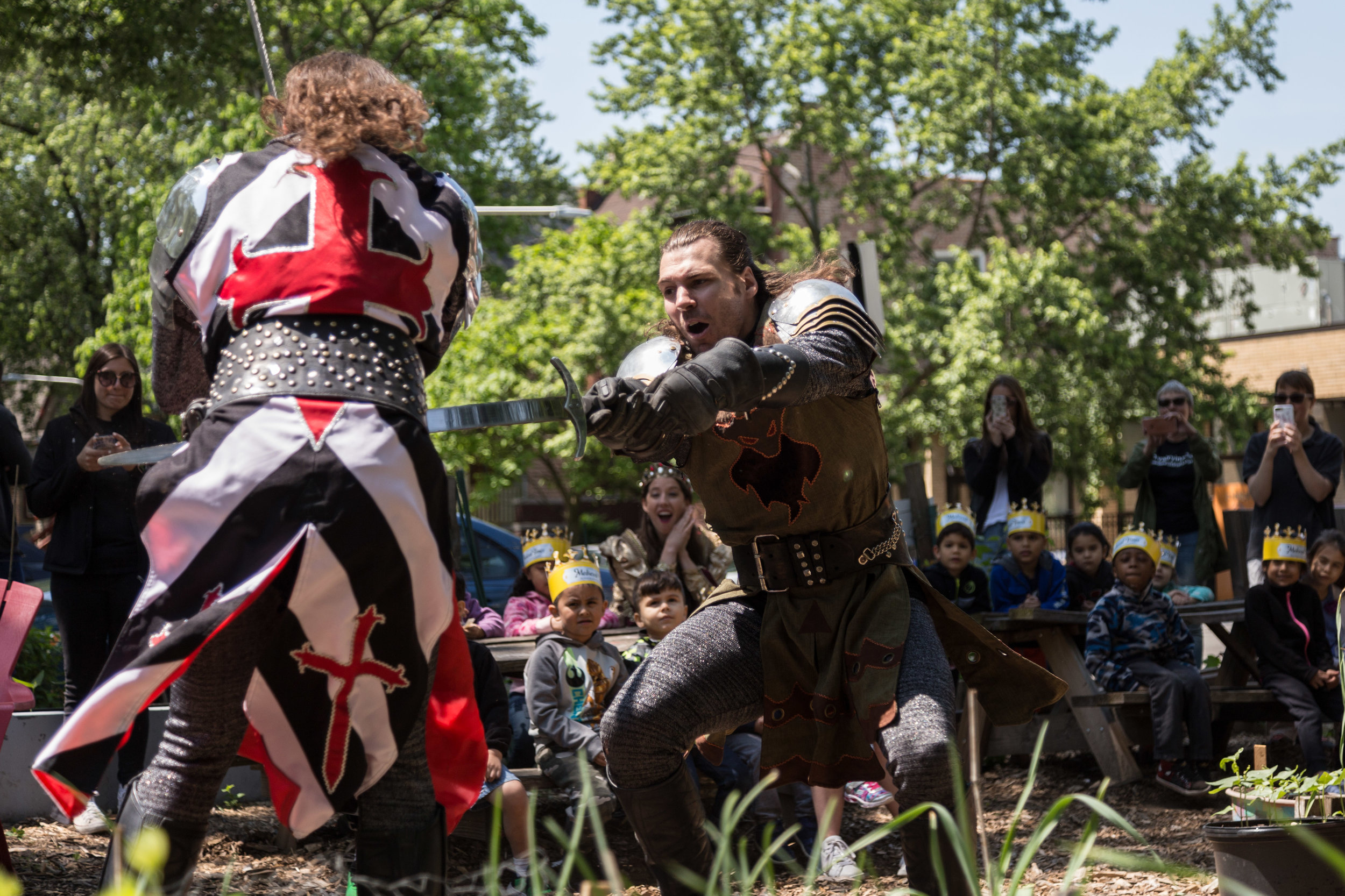 The Black & White Knight (Alec Lukie) and Green Knight (Michael Kiburz) battle at the Altgeld Sawyer Corner Farm.