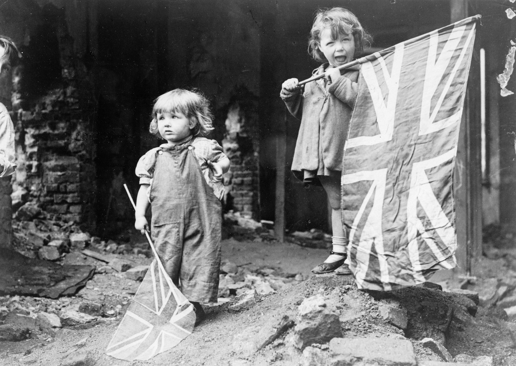 Two-small-girls-waving-their-flags-in-the-rubble-of-Battersea.jpg