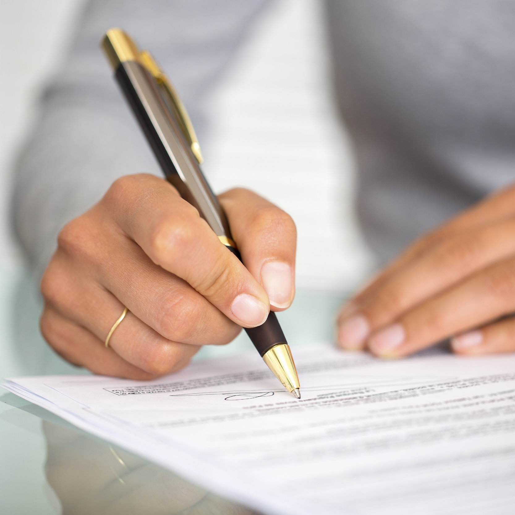 Signing-contract-pen-hand.jpg