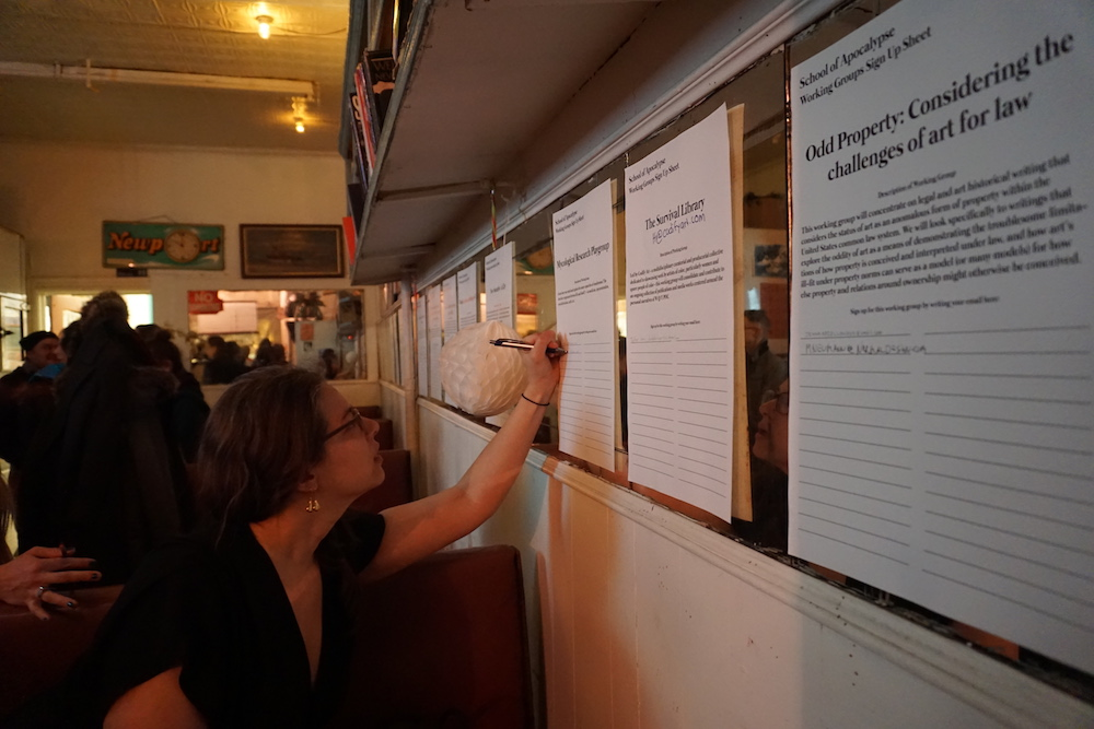 Michelle Jalowski signs up for a working group at Sunview Luncheonette in Greenpoint, Brooklyn.
