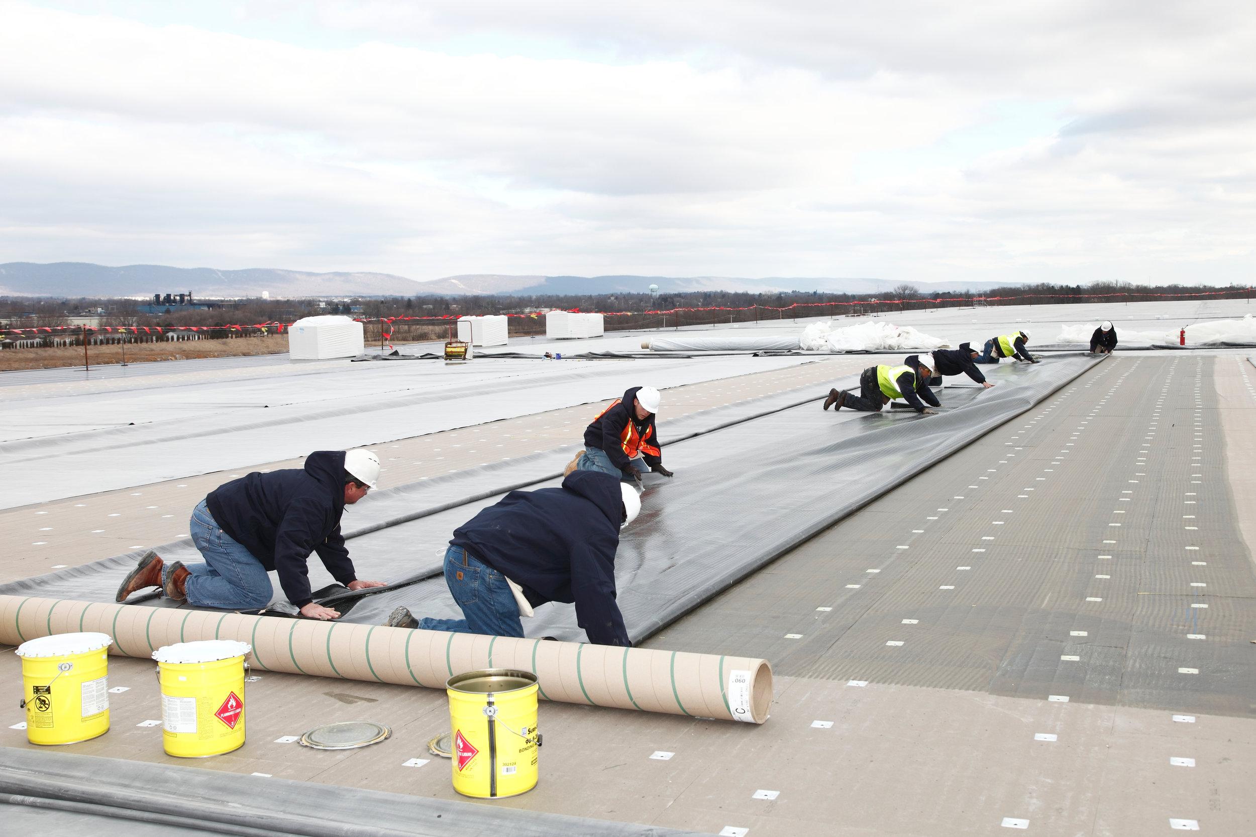 sure-seal-epdm-roof-install---carlisle-warehouse_19728092978_o.jpg
