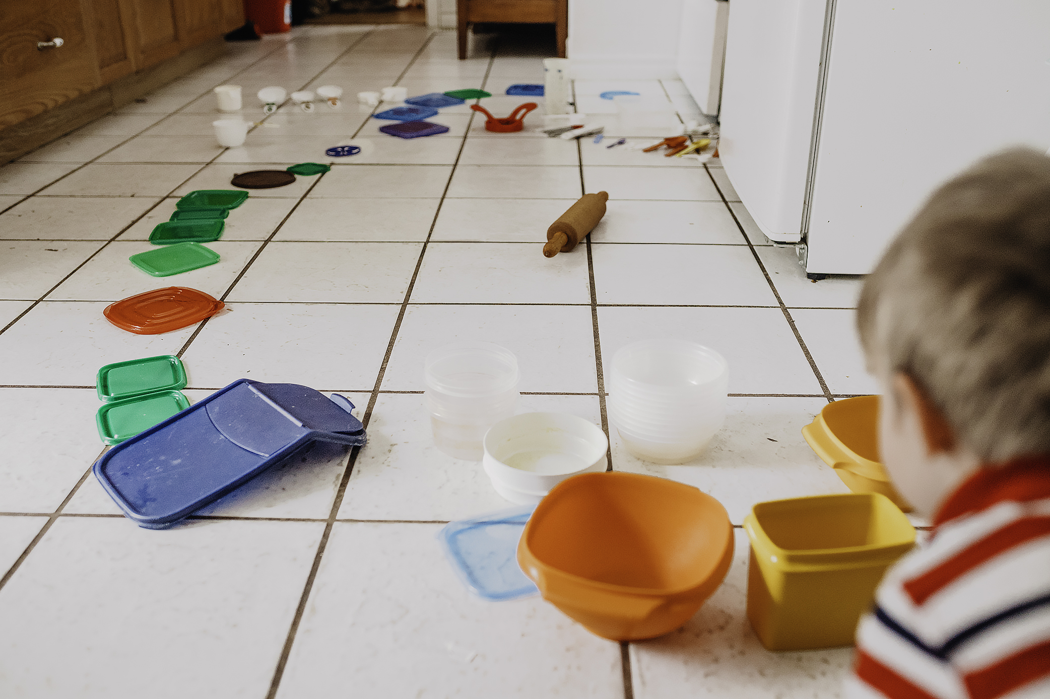 31. 365 - My son loves to sort and organize and line things up (and almost always he lines them up in an arc like this). Today he reorganized my mother's Tupperware cupboard.