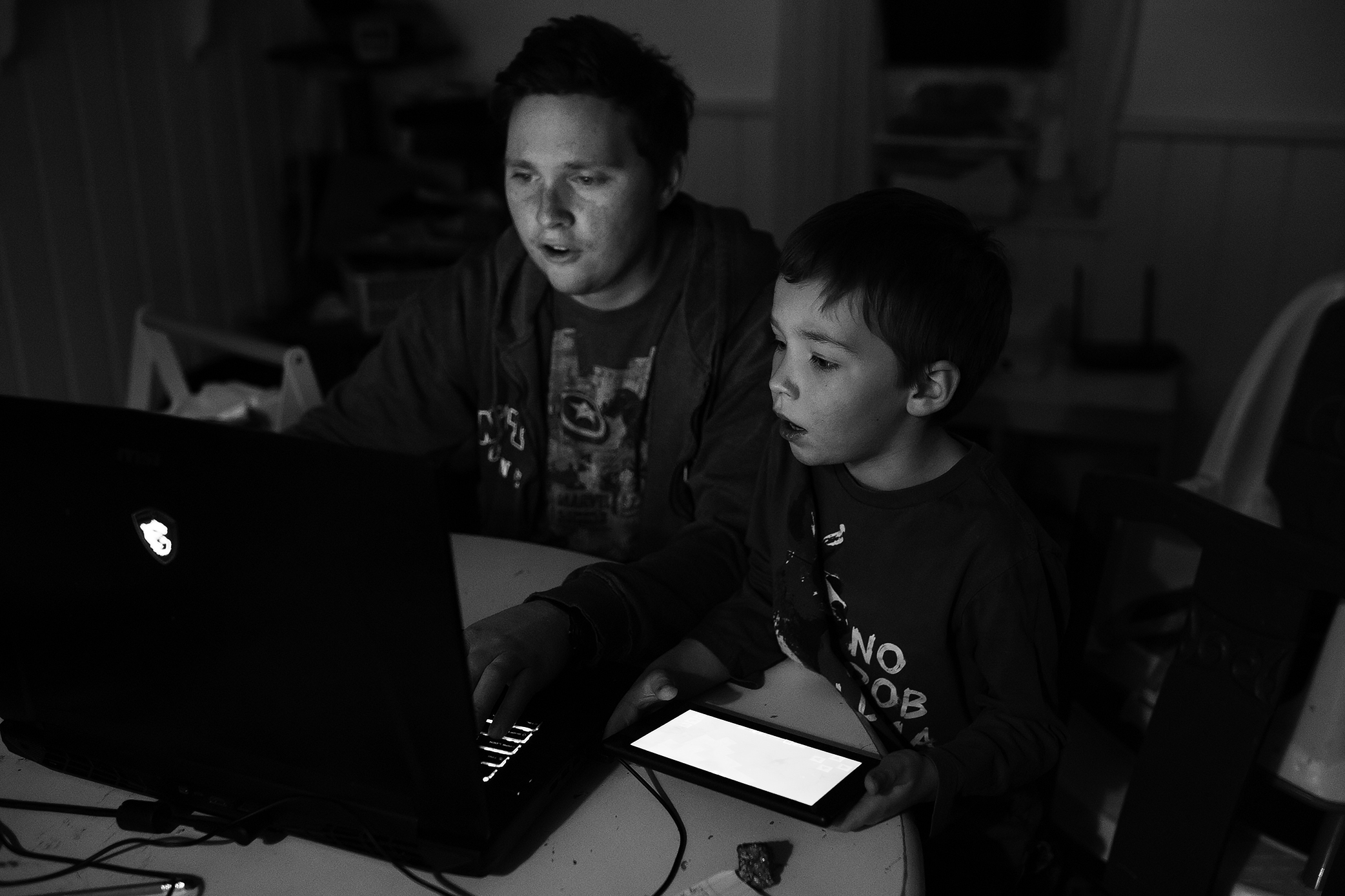 37. 365 - Father-son bonding over Minecraft. They are having a very intense discussion about what colour they should build their houses.