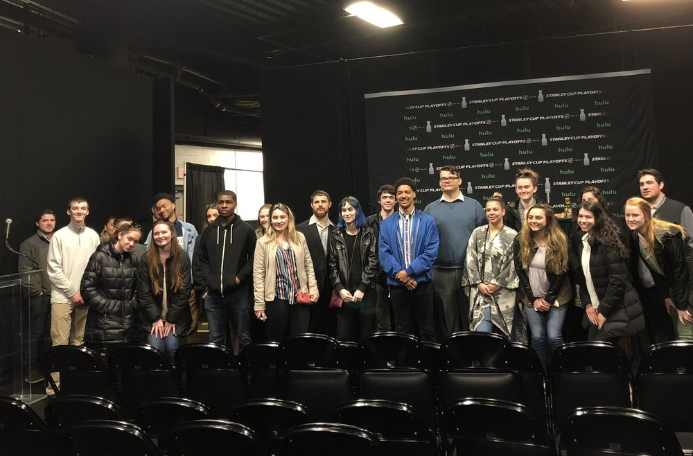 JWU SEEM students, along with Donna Remington of Experiential Education & Career Services and Associate Professor Dave Morris, took a behind the scenes tour of TD Garden / Delaware North before the Boston Bruins playoff game. The student group gathered for a photo in the Bruins press room.