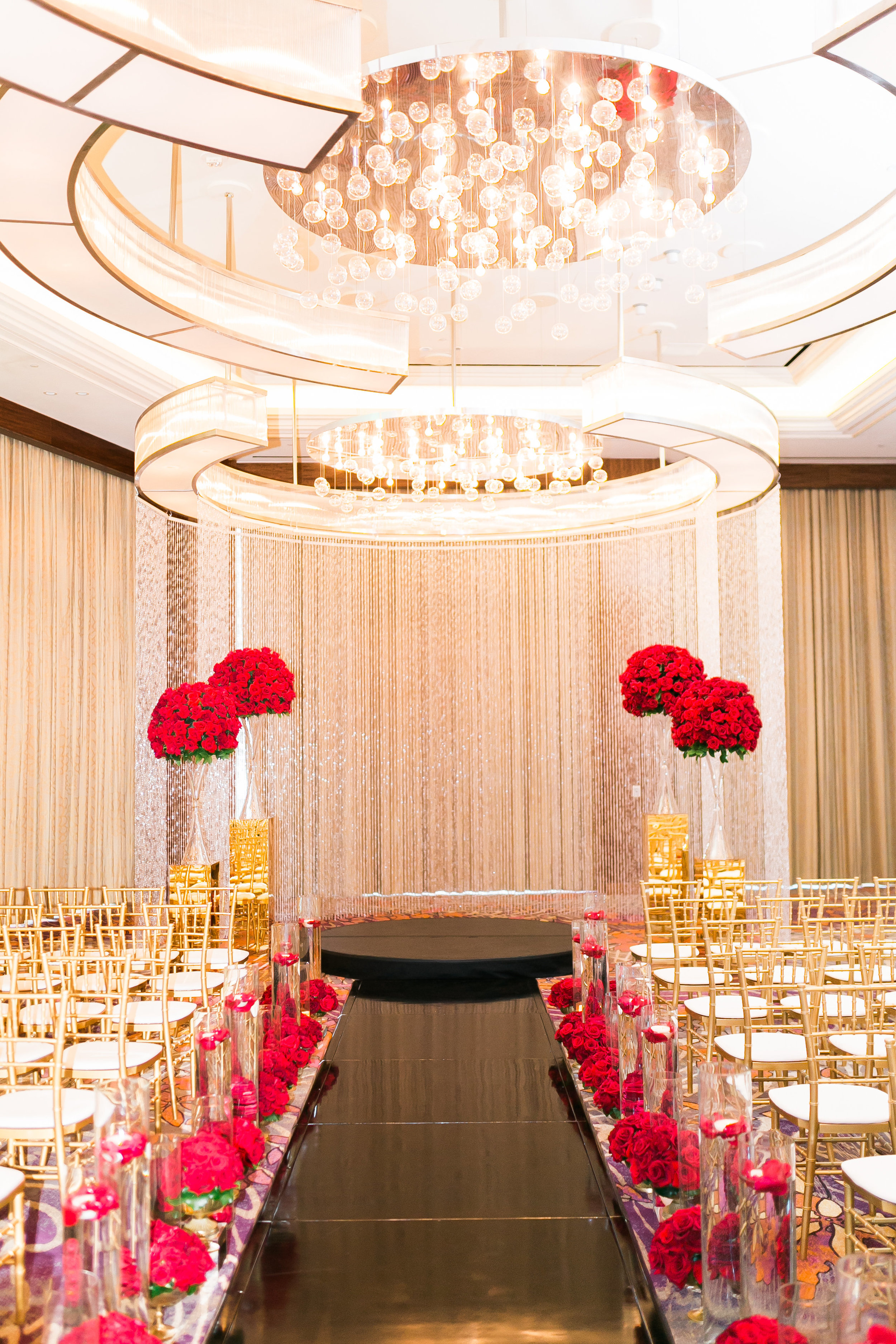 The red, black, and gold wedding featured a lot of bling!  Crystal drapes surrounded the ceremont alter.    Las Vegas Wedding Planner Andrea Eppolito.  www.andreaeppolitoevents.com  Photo by J.Anne Photography.  www.j-annephotography.com  As seen on The  Wedding Editorialist  Wedding Blog.