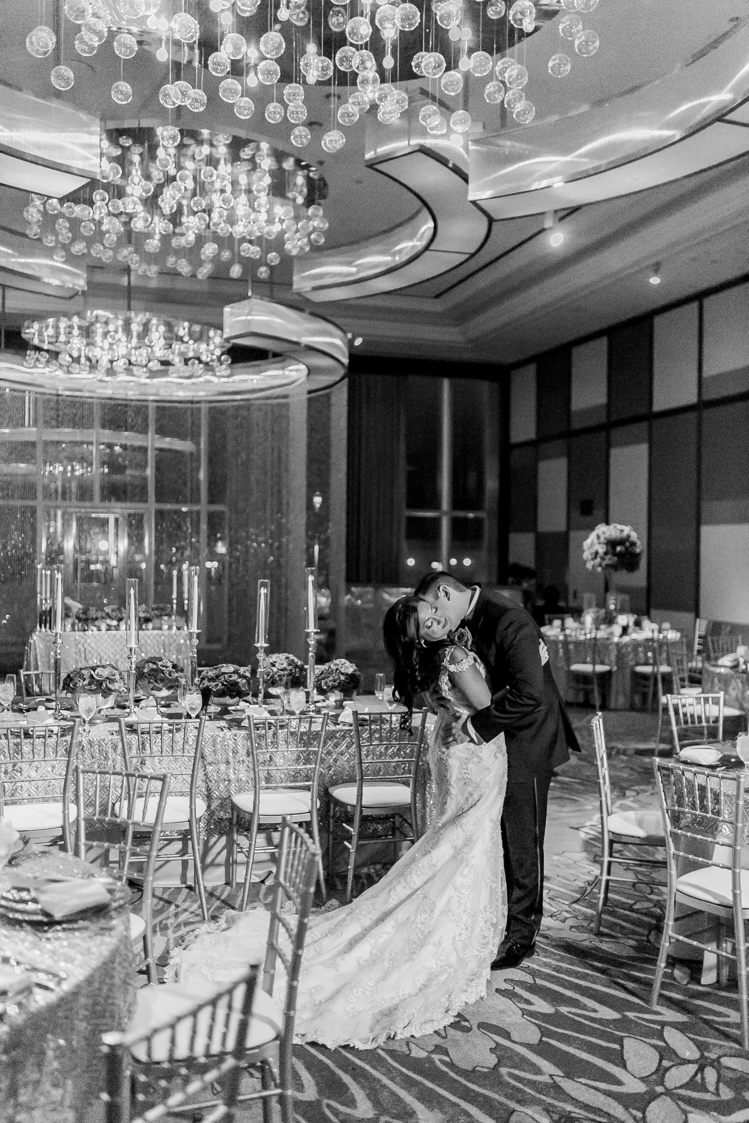 Black and White image of bride and groom in a passionate kiss.    Las Vegas Wedding Planner Andrea Eppolito.  www.andreaeppolitoevents.com  Photo by J.Anne Photography.  www.j-annephotography.com  As seen on The  Wedding Editorialist  Wedding Blog.