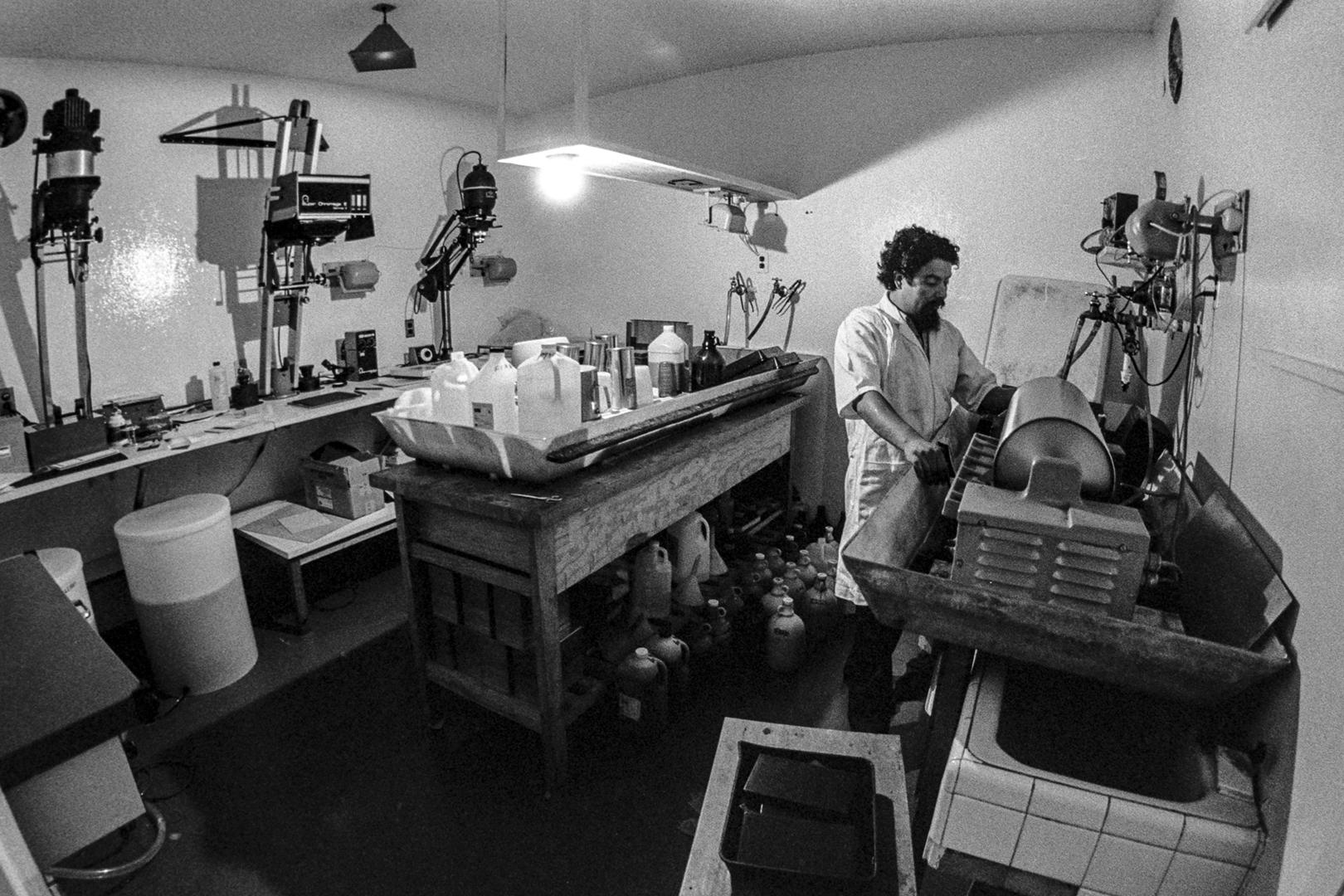 Schalwijk's lifetime asistant,Javier Tinoco, working in the enlarger room.