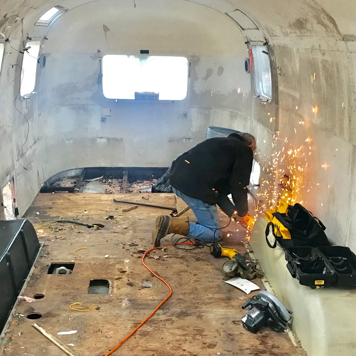 David hard at work on removing the floor. January 2017.