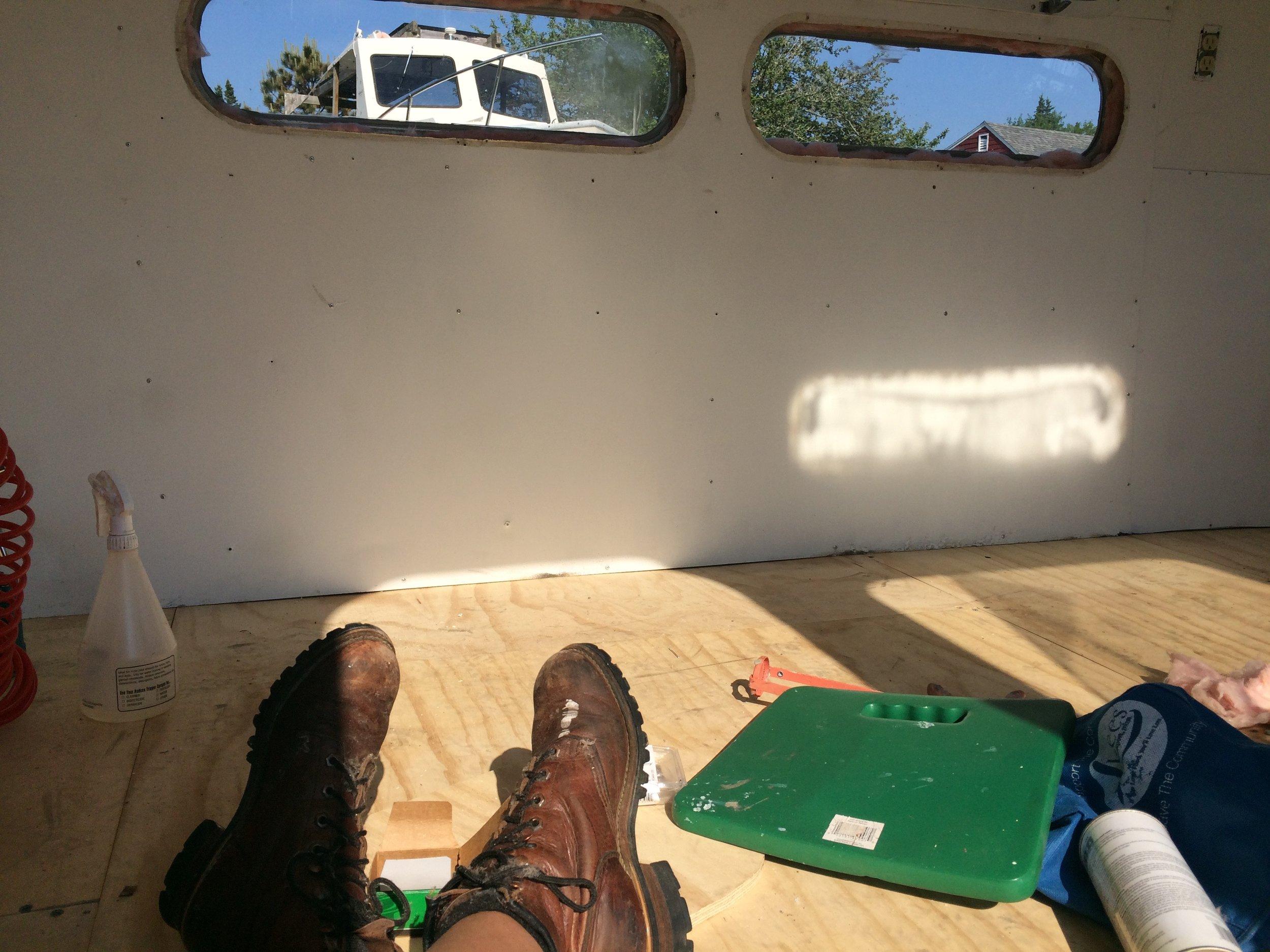 Taking a break on Cilla's new plywood floor.