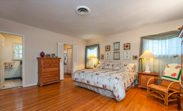 The master bedroom is the largest of the 4 in the house and features original hardwood flooring and an en-suite master bathroom. Its larger than it appears in photos, with room enough for your or your dream life.