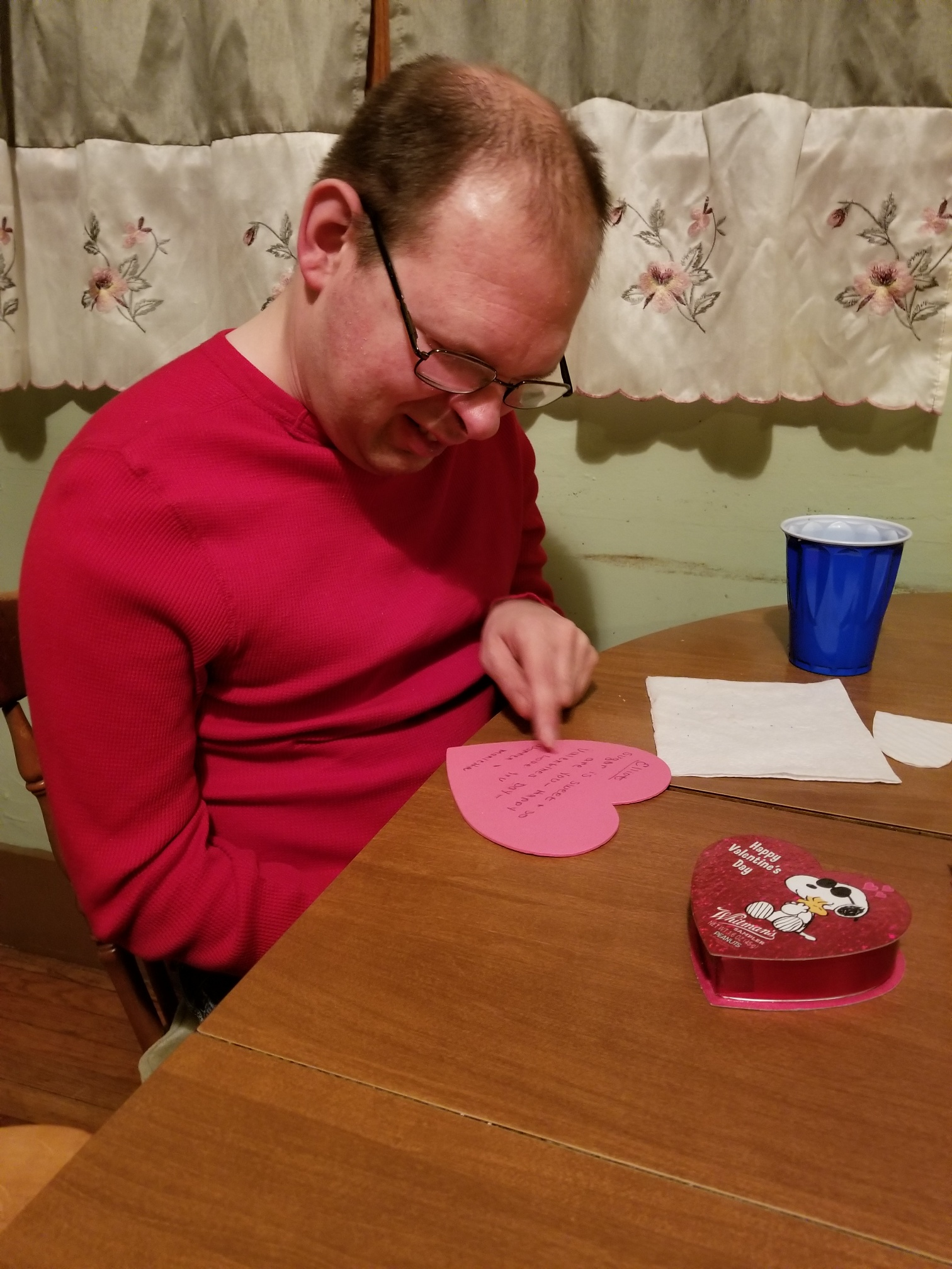 Reading a note from his Valentine.