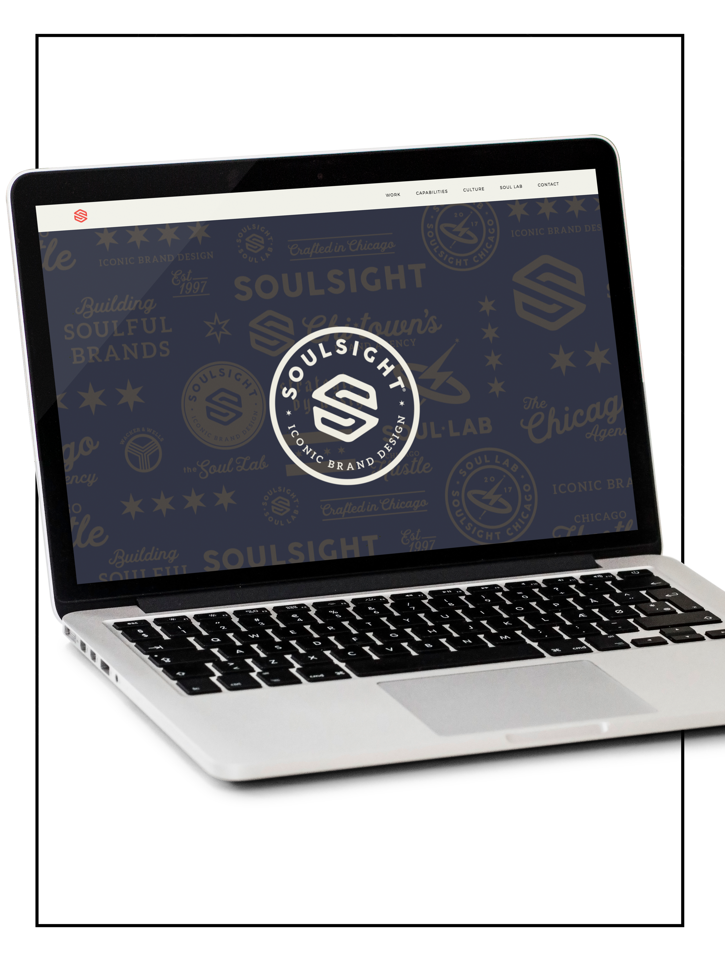 Showcasing an image of a laptop with a website build of Spacebar Agency - Soulsight Agency