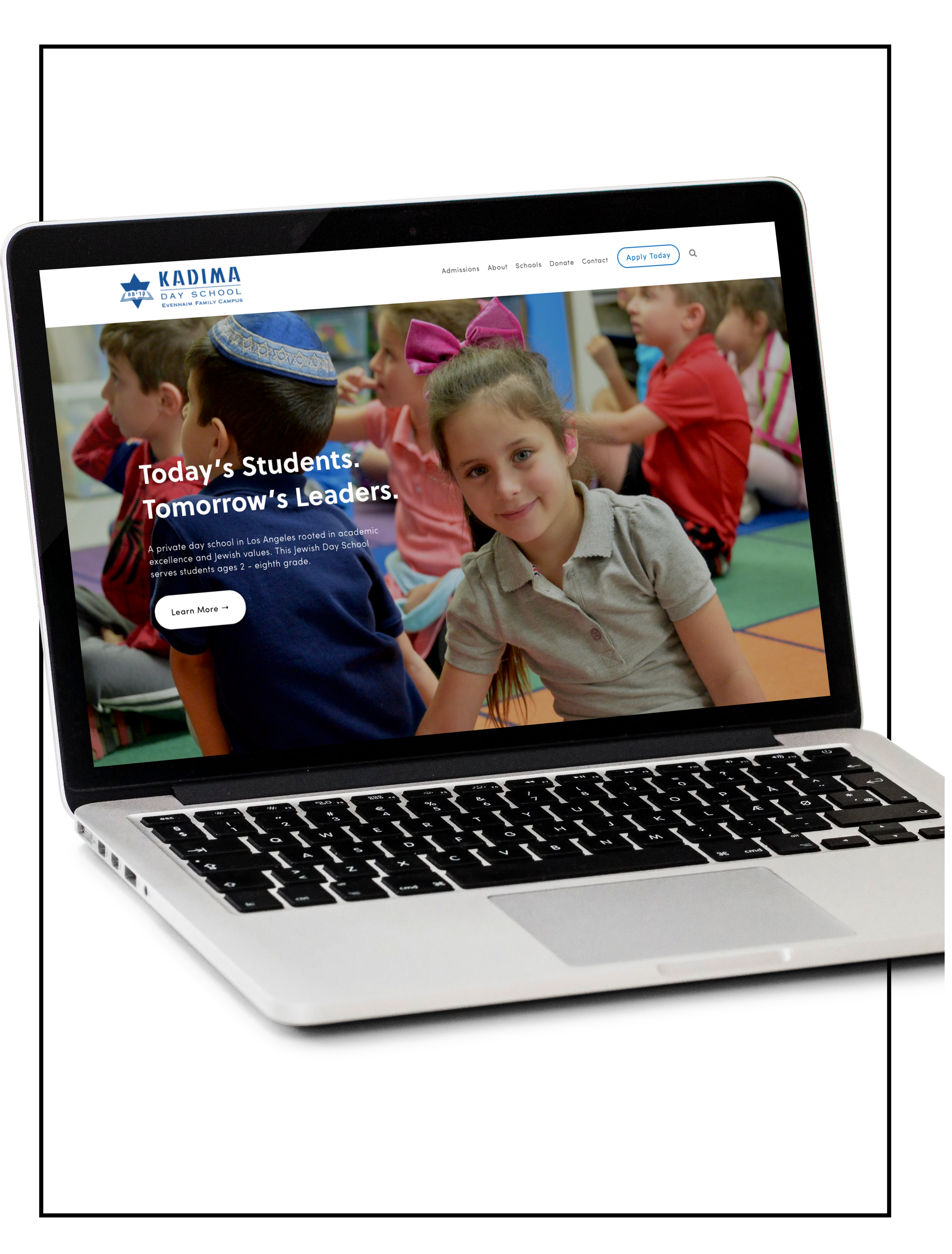 Showcasing an image of a laptop with a website build of Spacebar Agency - Kadima Day School