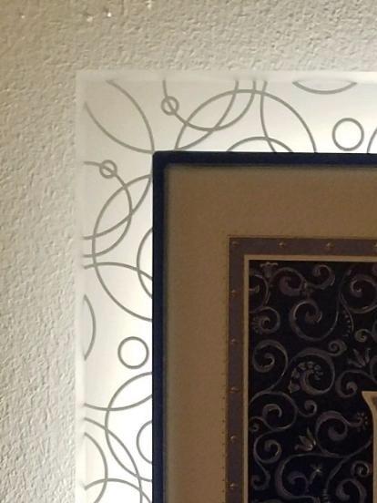 A detail of the corner of the lit up Ketubah.