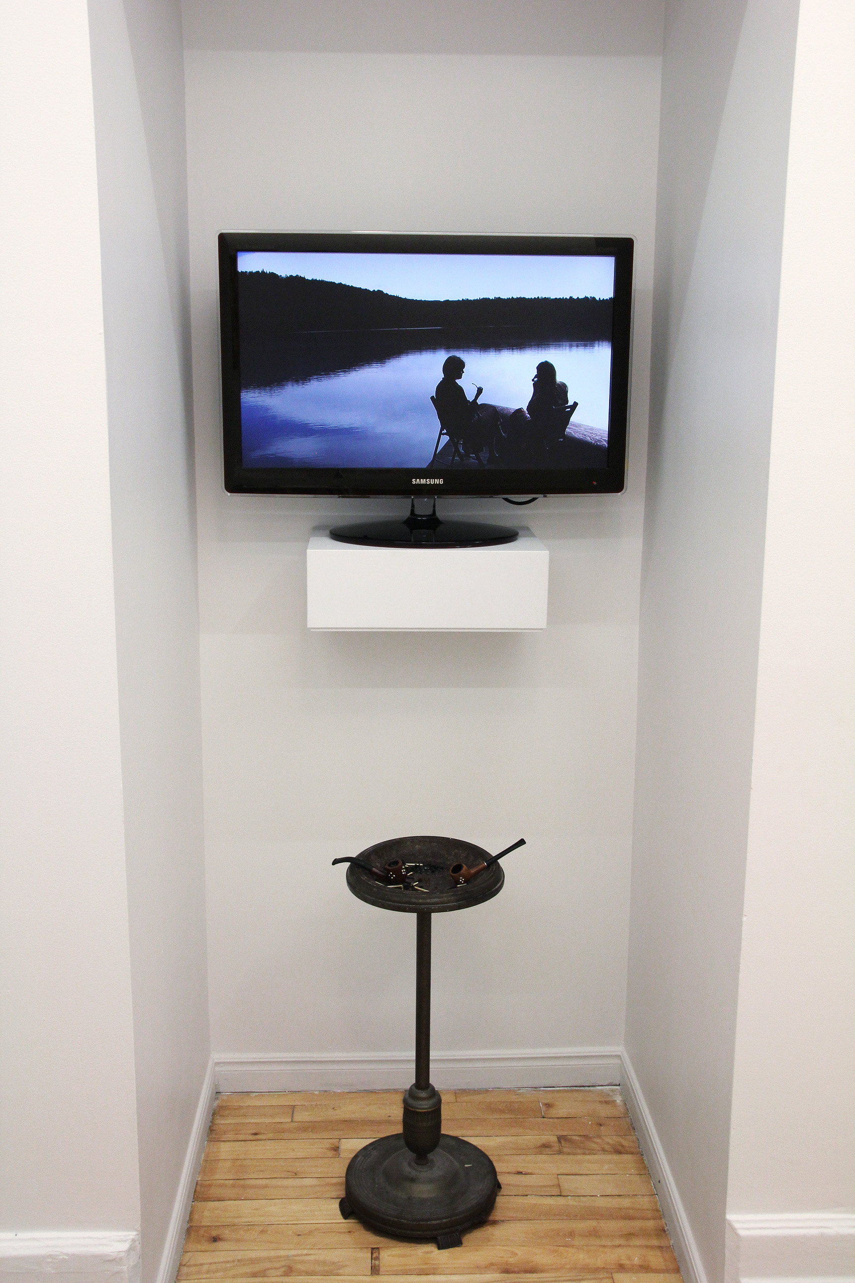 Installation view. Leisure (Wesley and Carruthers),  A Shared Puff , video and objects, 2012.