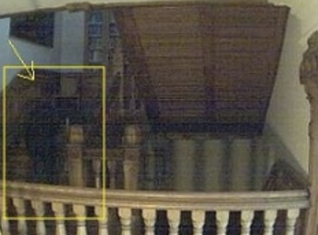 A shadow figure appears to descend the stairs.