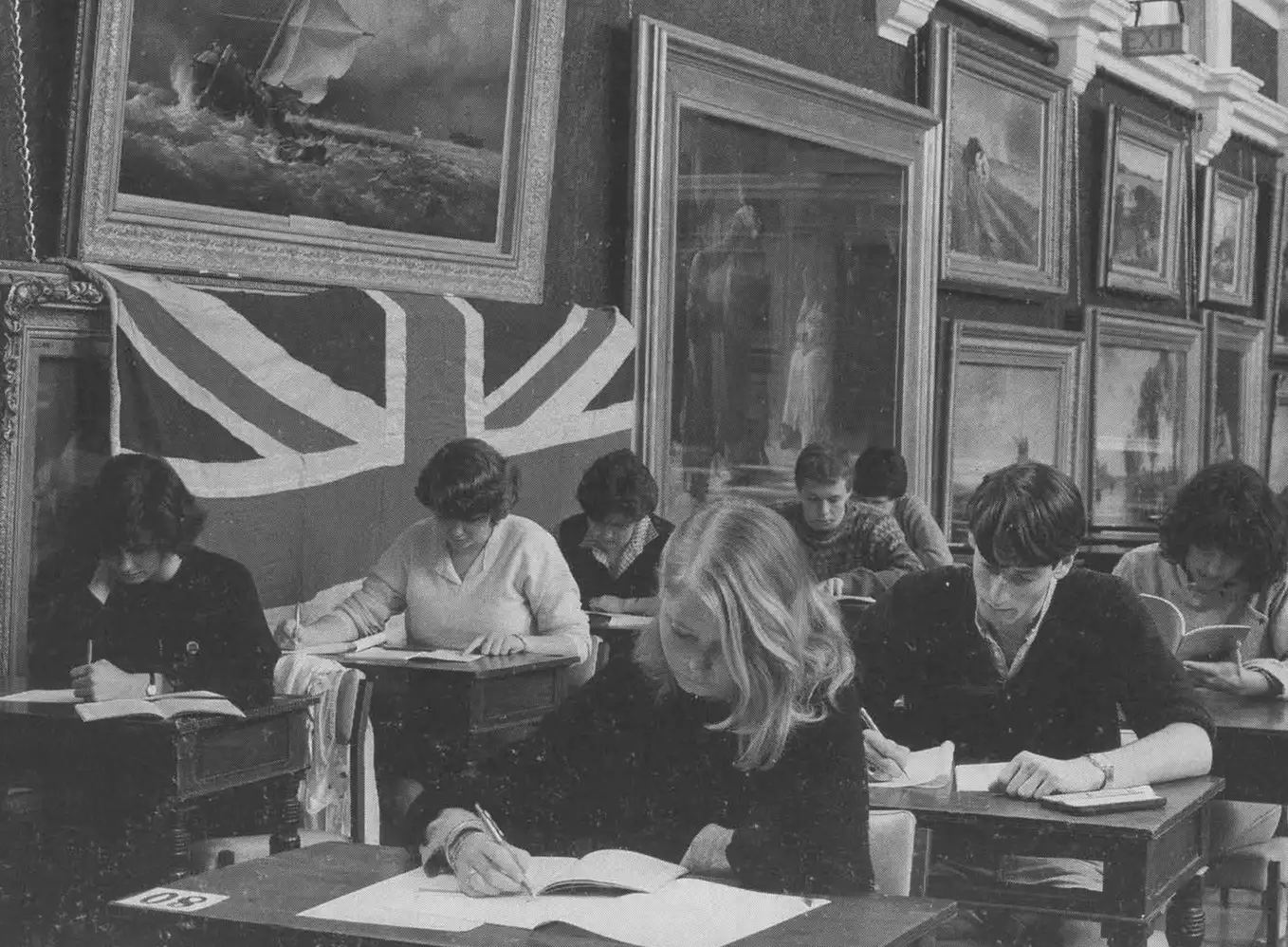 The cursed painting covered by the Union Jack flag.