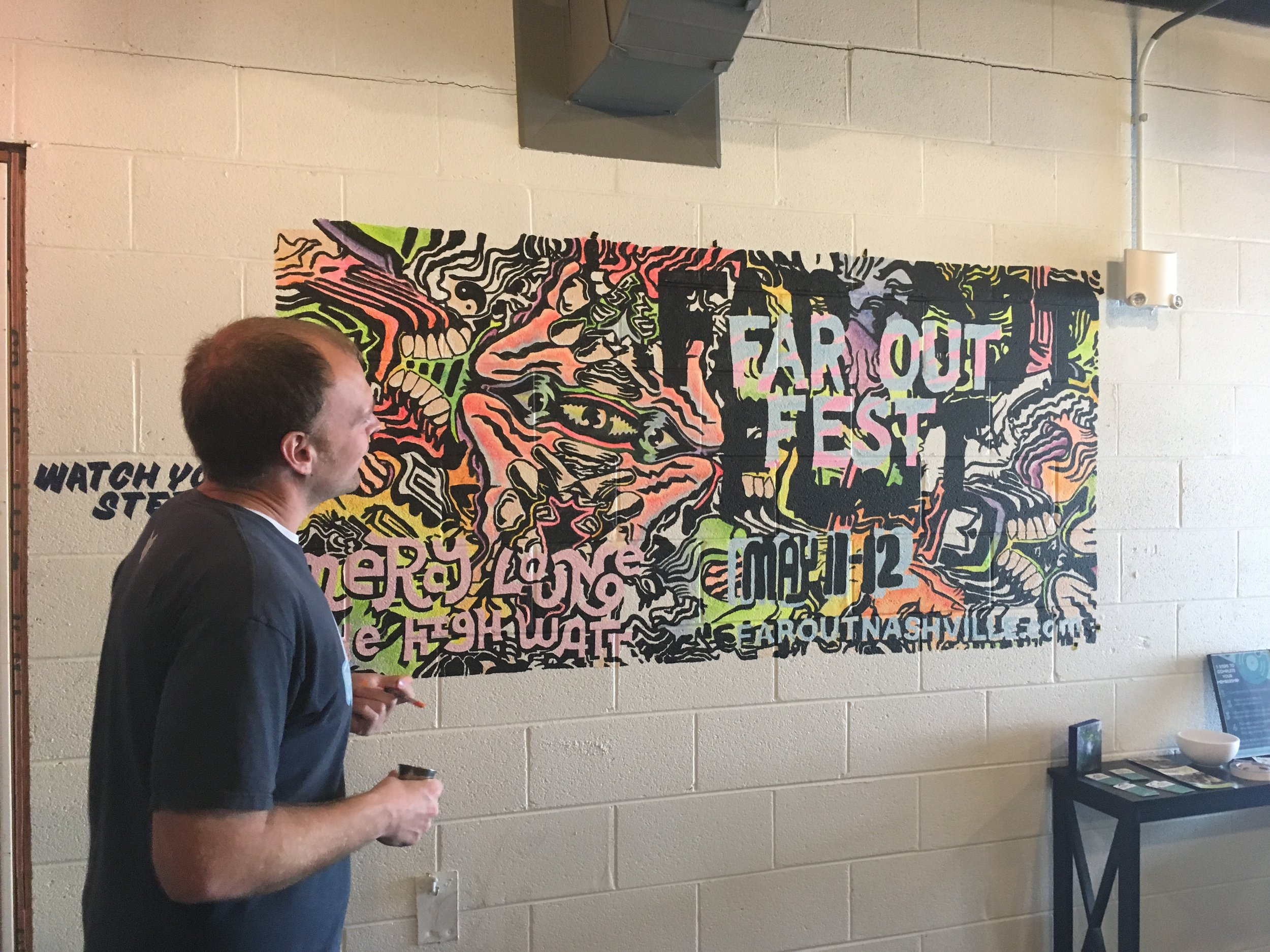 Lance Turner with the Far Out mural