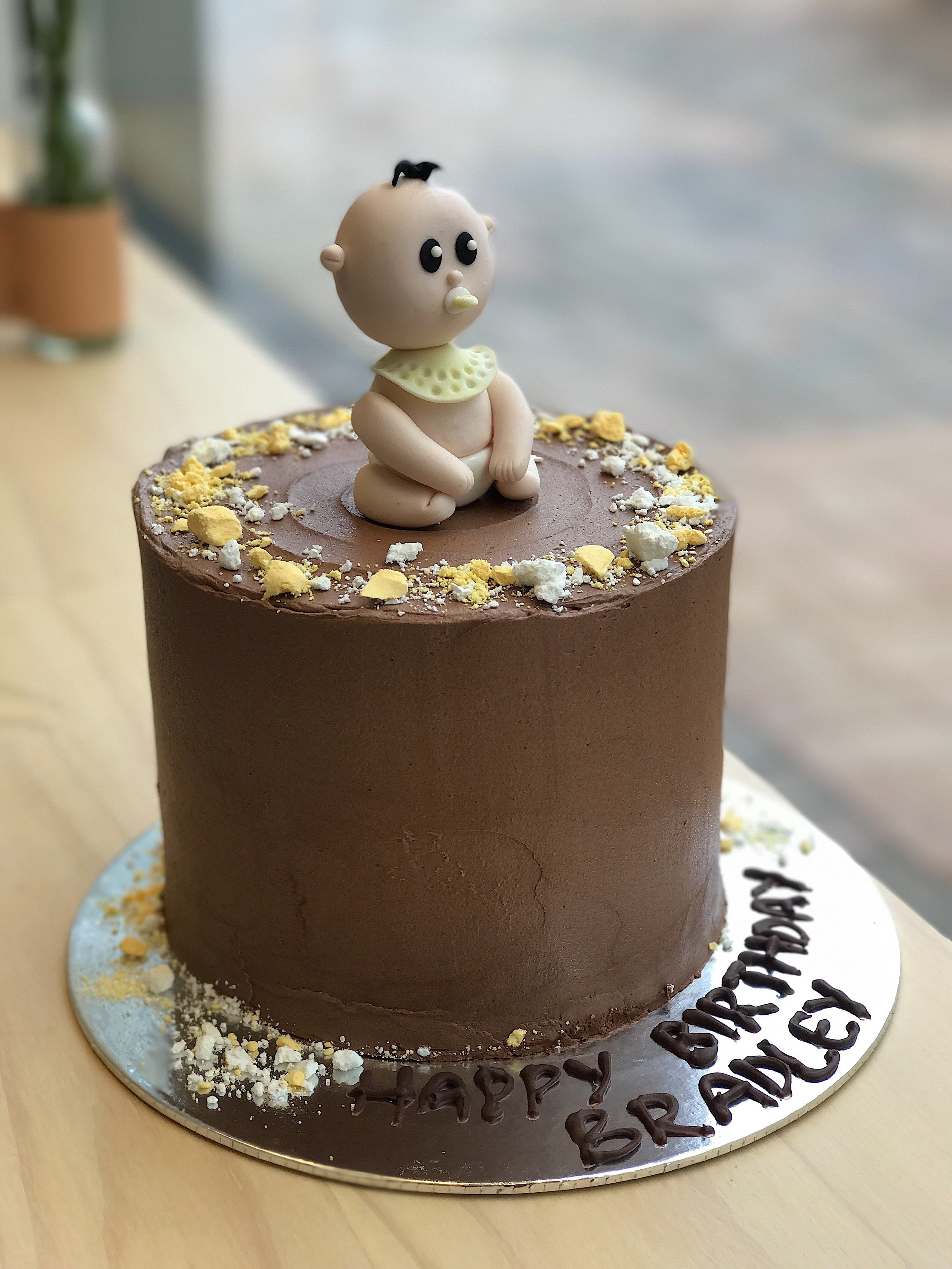 gender neutral baby shower cake with baby topper.jpg
