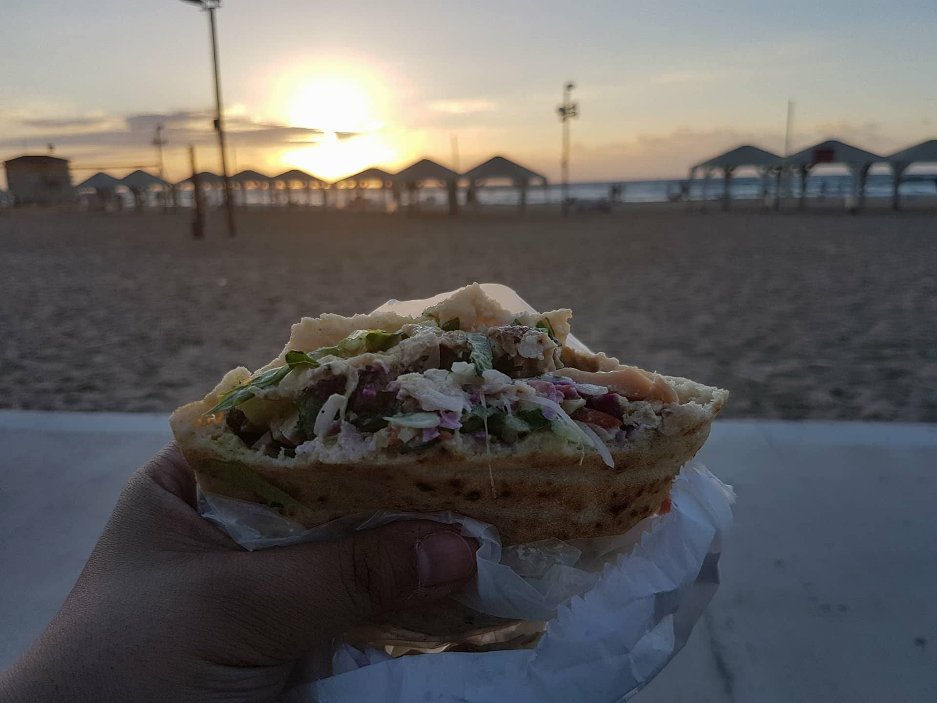 Sabich on Tel Aviv Beach with the sunset. Copyright: Sherry Bekhet