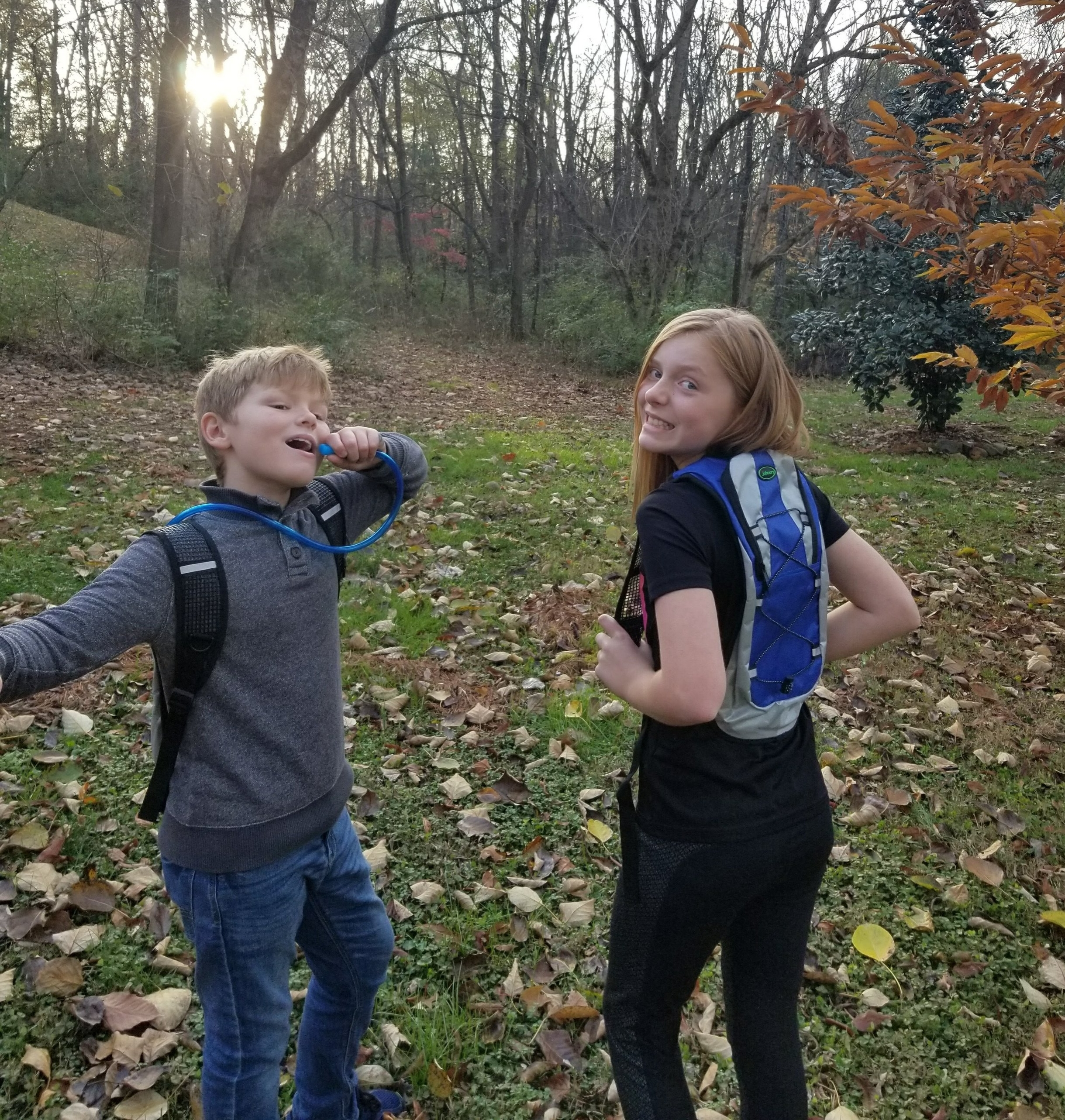 The kids demonstrating their hydration packs.