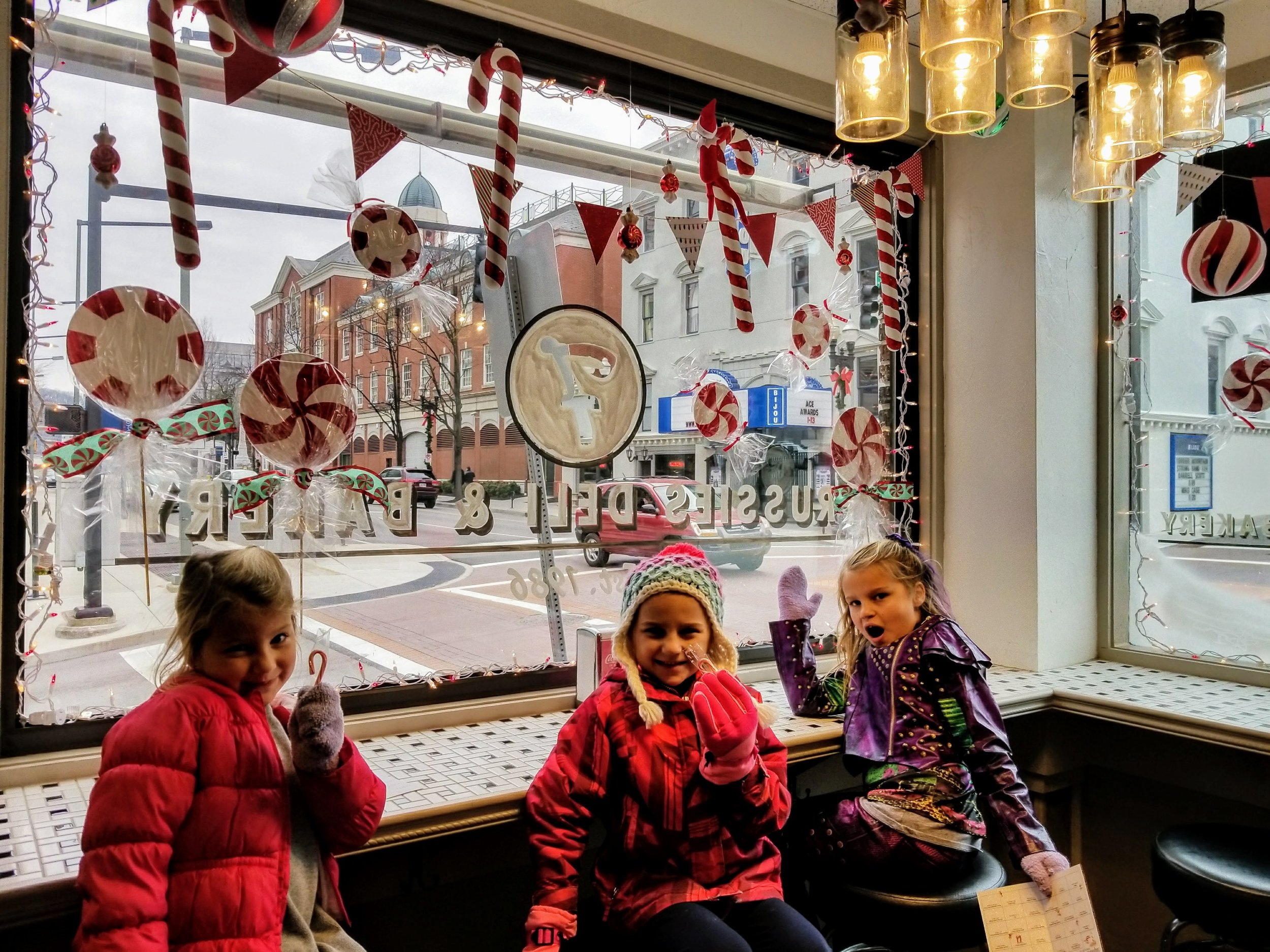 Frussies Deli and Bakery was a hit with the kids because they gave them candy canes. See if you can spot the elf in the picture.