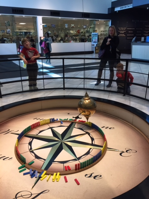 Foucault's pendulum in the lobby of the museum. Lots of kids gathered around it and cheered when it knocked down a peg.