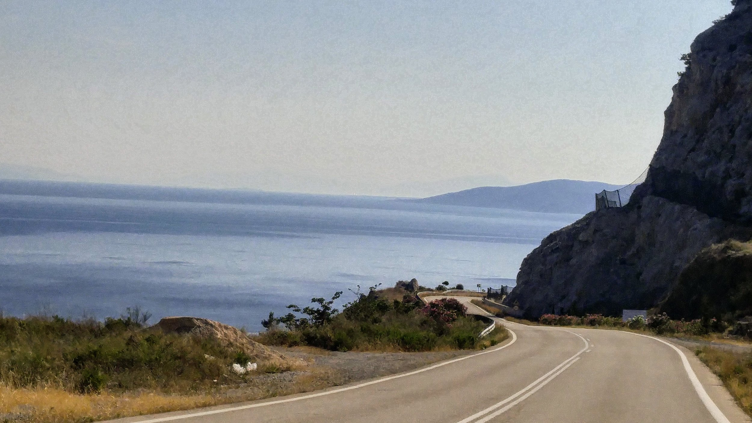 Typical view while driving a coastal road.
